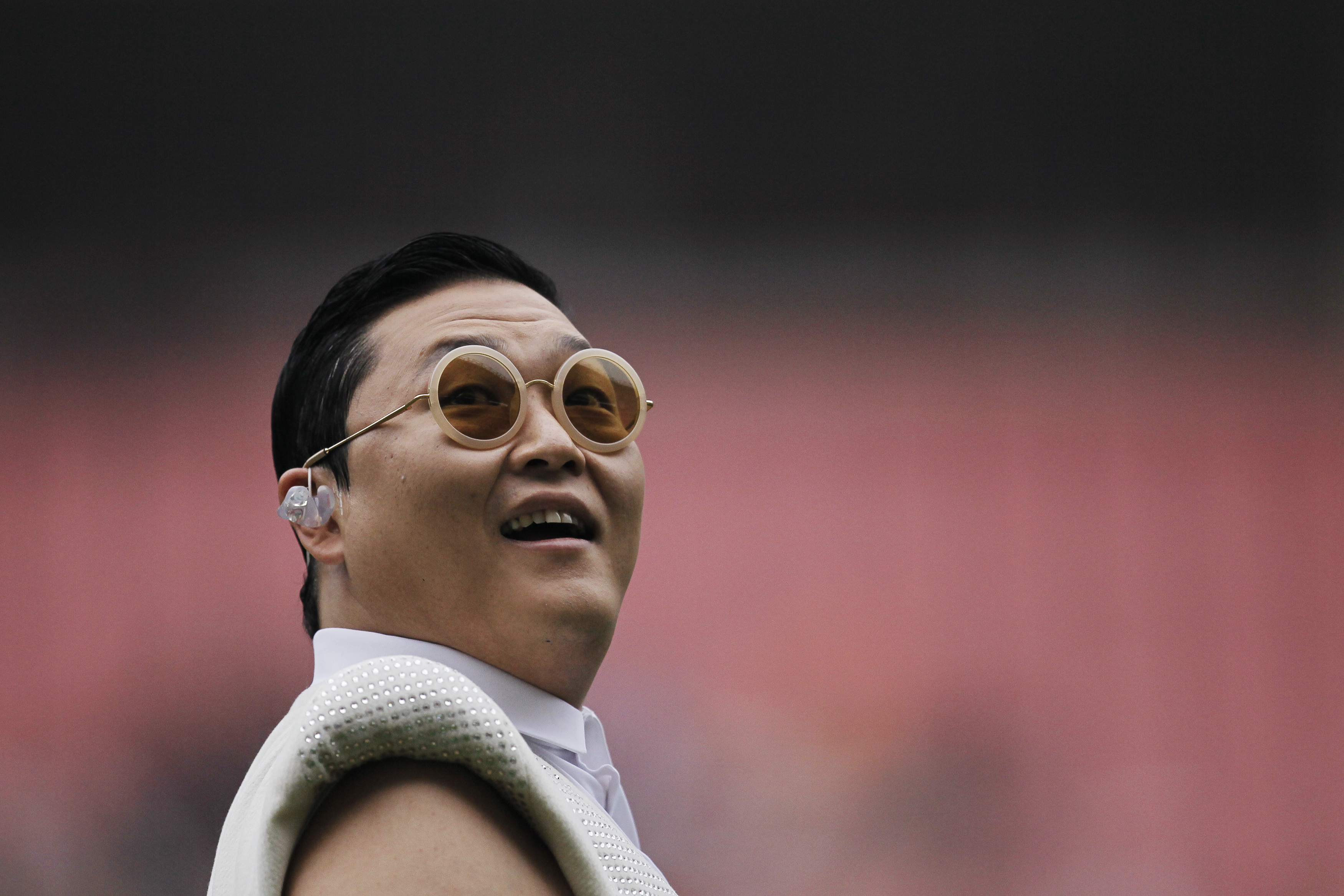 South Korean singer Psy performs during a charity soccer match in Shanghai on June 23, 2013