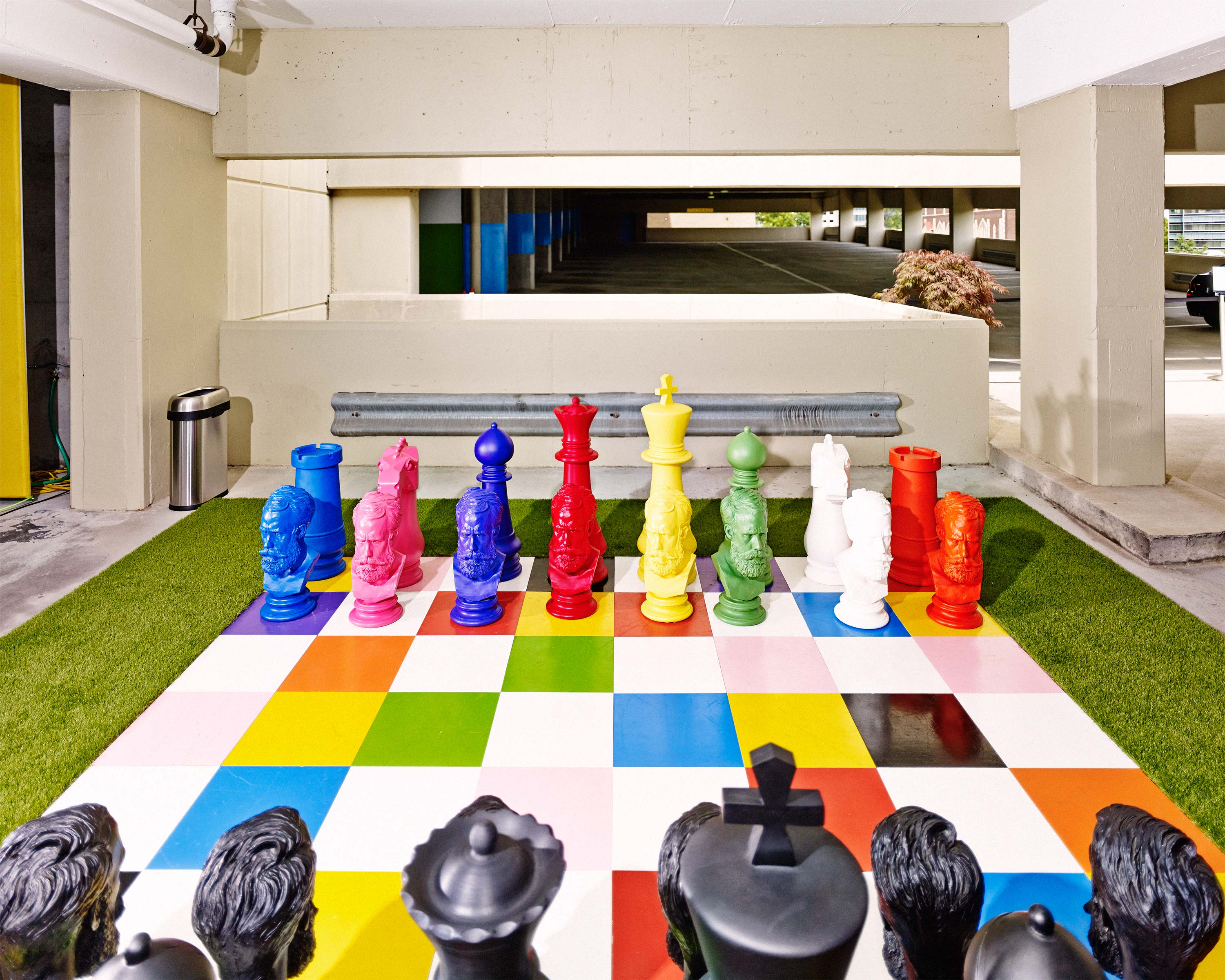 """Other elements, such as the life-size chessboard, help to foster a mini-community. """"I had friends over to watch The Fifth Element                               on the ceiling of the parking deck,""""                               she says. """"It was like living in a piece of                               the future."""""""