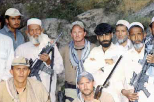 Major Jim Gant, center, with local Afghans and his soldiers in Afghanistan.