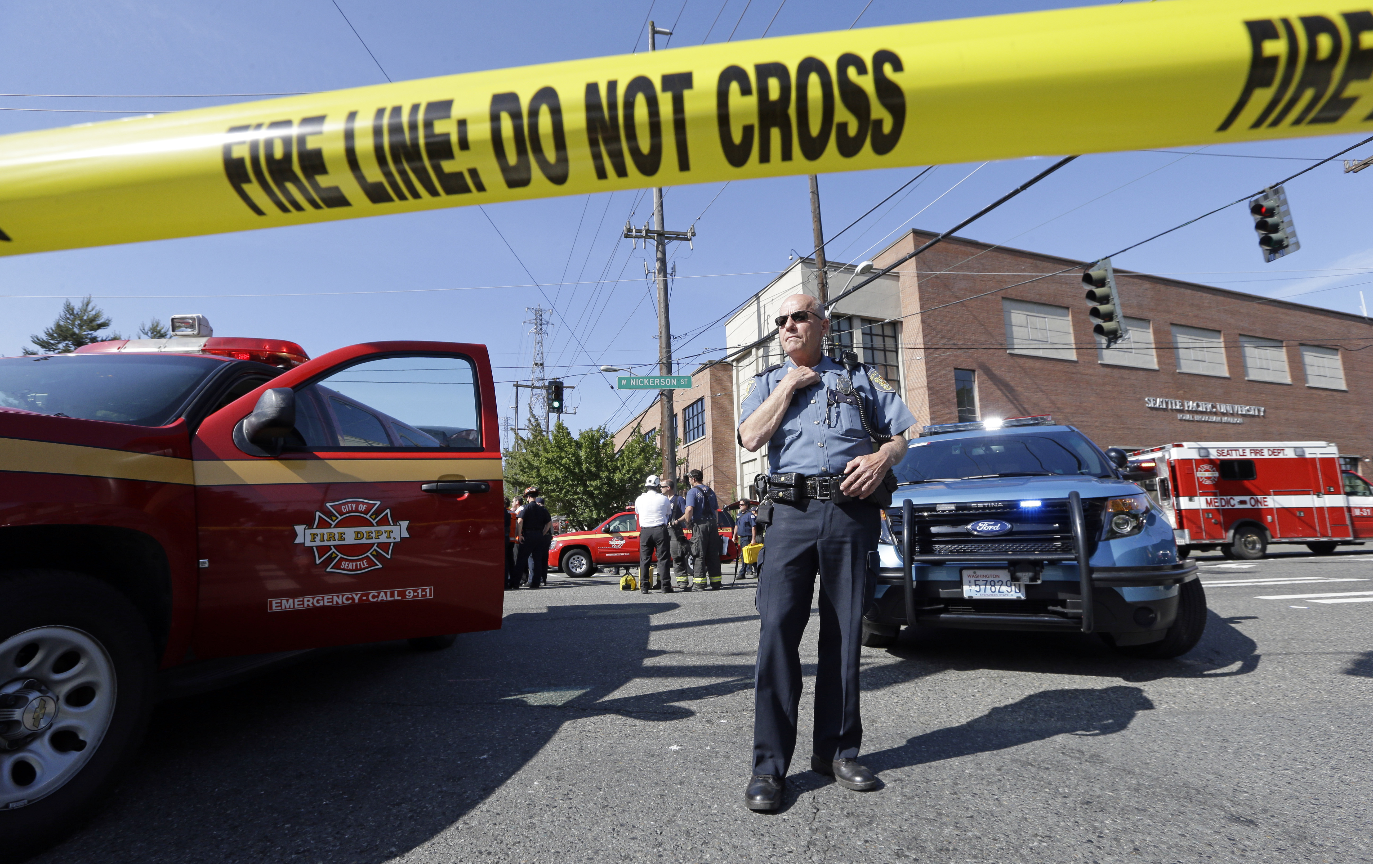 A police officer stands near the scene of a shooting on the campus of Seattle Pacific University in Seattle, June 5, 2014.