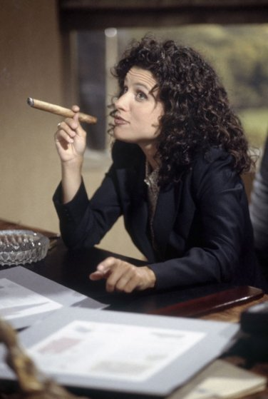 """Julia Louis-Dreyfus as Elaine Benes in Episode 1 """"The Foundation"""" from the television show Seinfeld."""