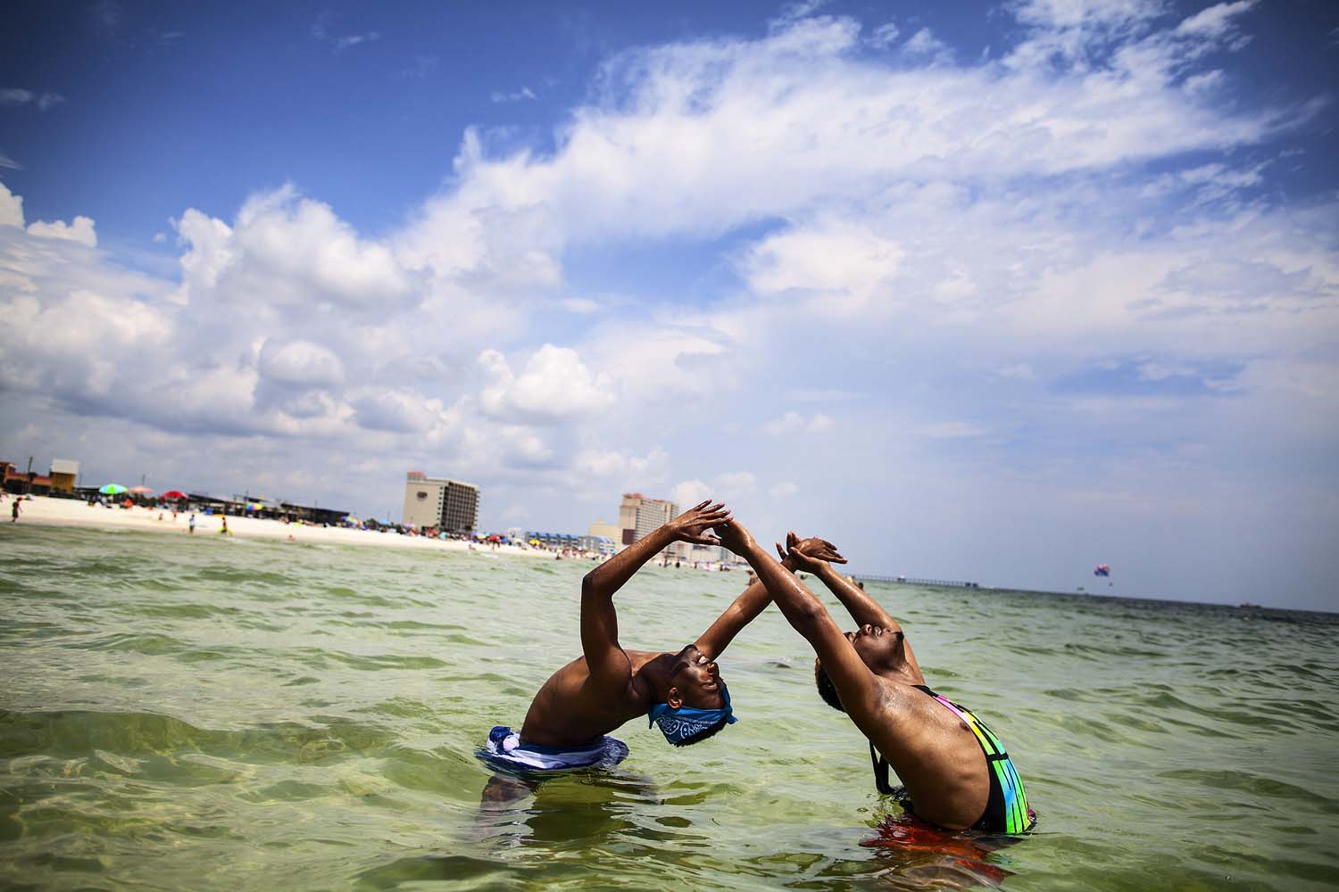 Jerel and Kentrell frolick in the waters off the coast of Alabama, in the Gulf of Mexico.