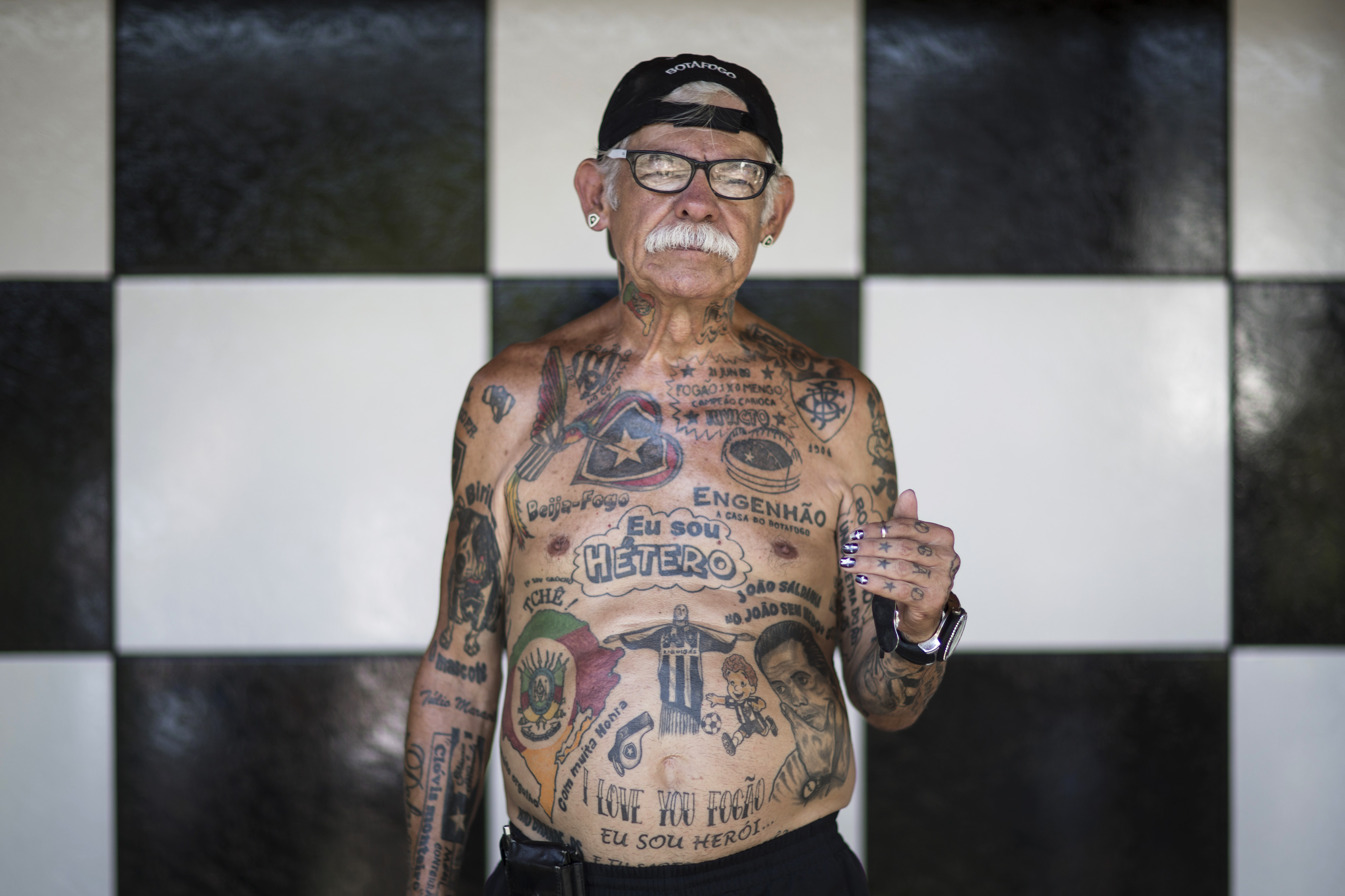 Soccer fan Delneri Viana poses for a photo in his home, decorated with Botafogo colors in Rio de Janeiro, Brazil on May 8, 2014. Viana has 83 and counting tattoos and never wears anything without the team's emblem.
