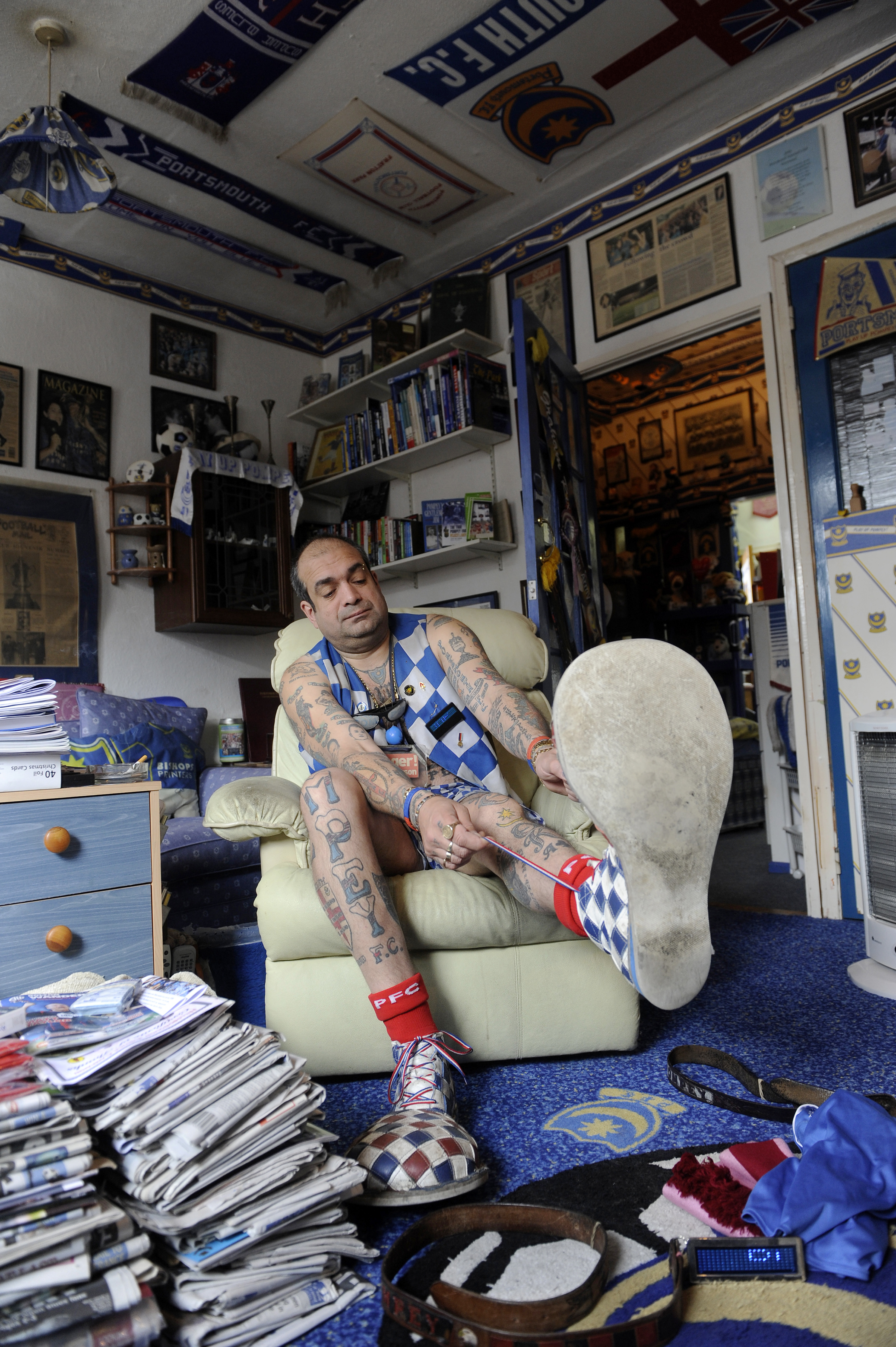 John Westwood poses for a photo in his home in Portsmouth, England on May 1, 2010. In 1989 John Westwood changed his name to John Anthony Portsmouth Football Club Westwood.  Westwood has over 60 Portsmouth tattoos on his body.