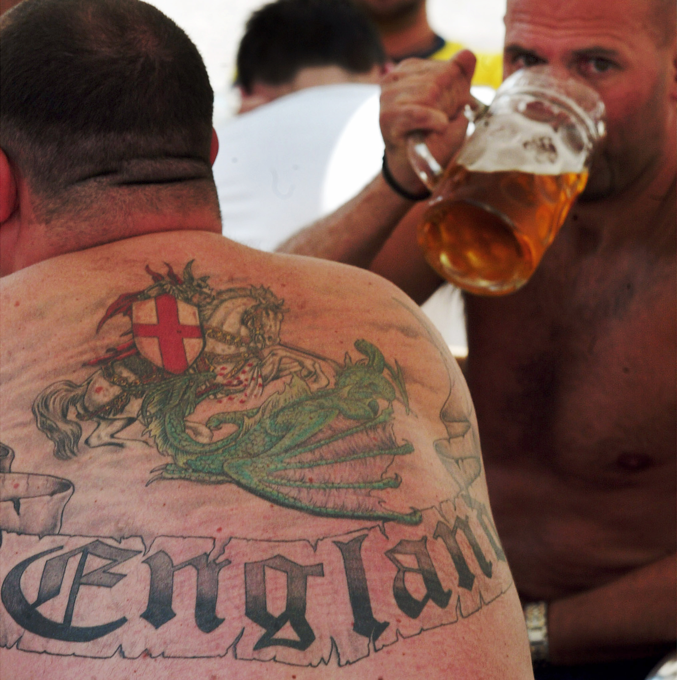 England fans drink beer on a cafe terrace in Lisbon efore England and France play the first match of UEFA Euro 2004 on June 13, 2004.