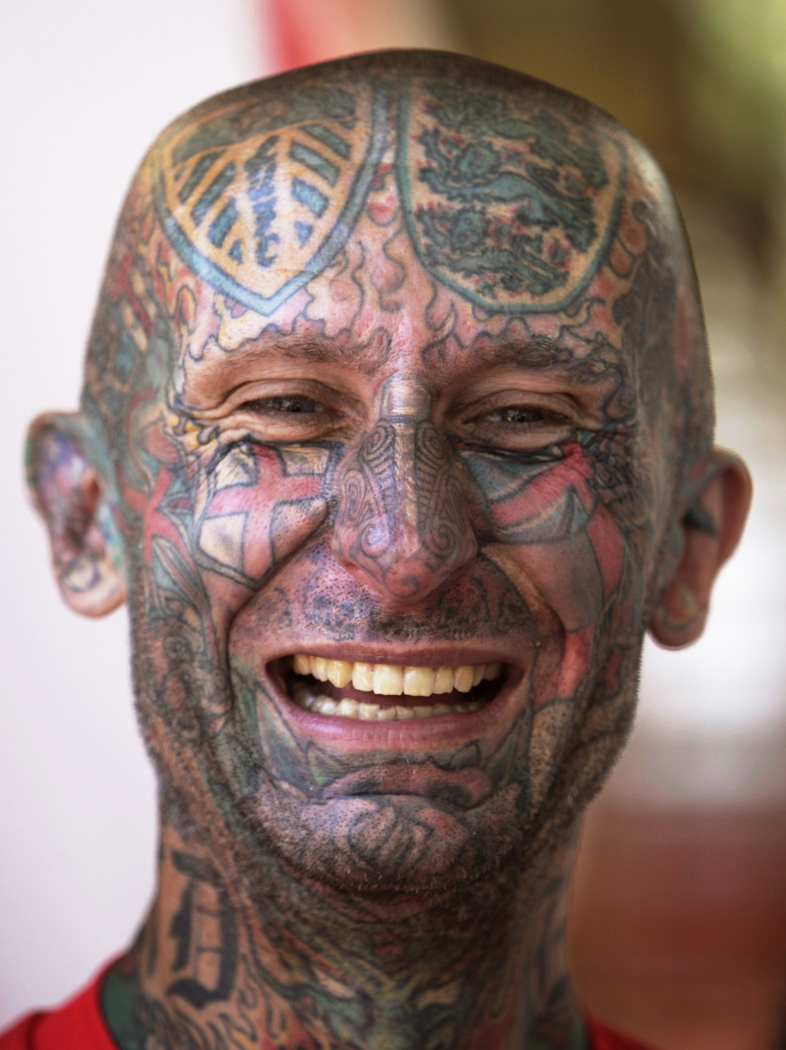 British soccer fan with a tattooed face smiles prior to England's first match of the Euro 2012 soccer championships against France on June 11, 2012 in Donetsk, Ukraine. on Monday.