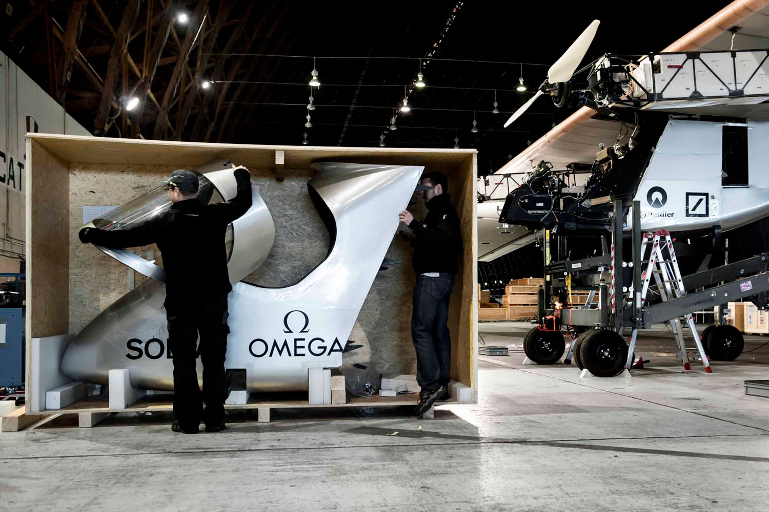 Solar Impulse's HB-SIA prototype is reassembled after arriving from Switzerland on board a Boeing 747 cargo plane.