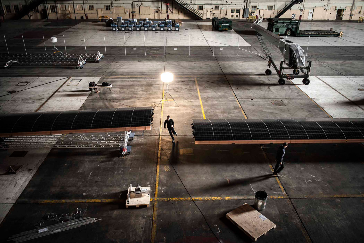 Solar Impulse's HB-SIA prototype is being reassembled after arriving from Switzerland on board a Boeing 747 cargo plane in Mountain View, Calif.