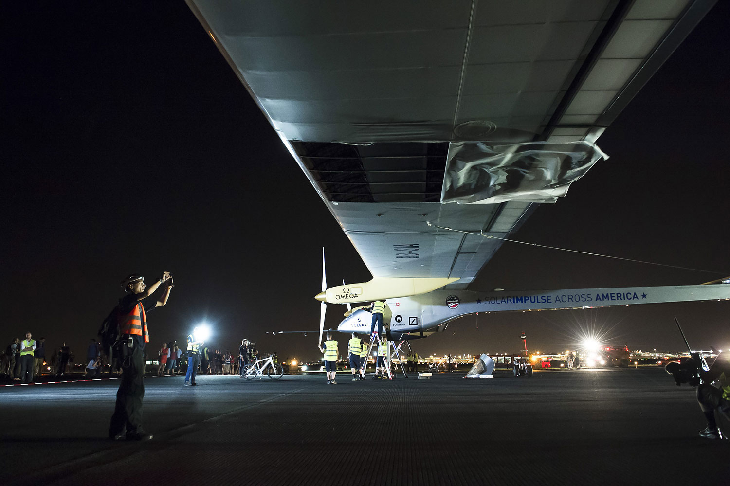 A tear in the wing fabric of the Solar Impulse airplane following landing at John F. Kennedy International Airport in New York, July 6, 2013.