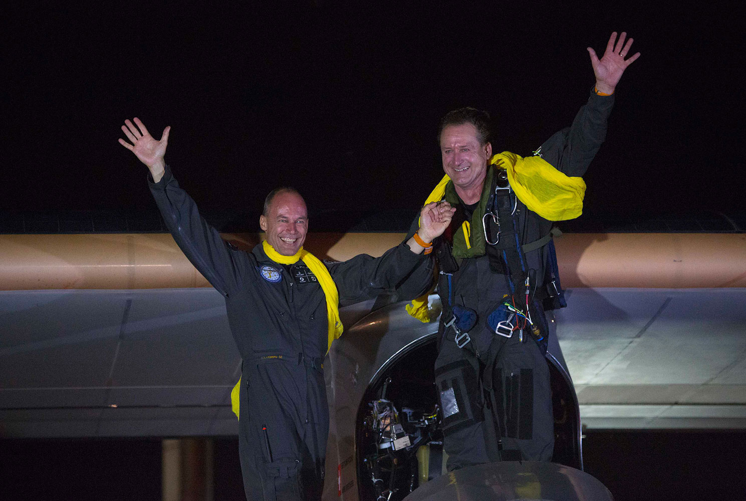 From left: Bertrand Piccard and Andre Borschberg after Solar Impulse lands at JFK airport in New York on July 6, 2013. The airplane touched down in New York City late on Saturday, completing the final leg of an epic journey across the United States that began over two months ago.