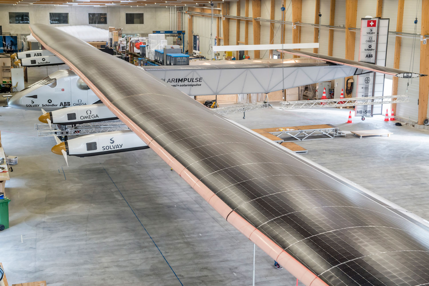 "Solar Impulse 2, the second solar powered aircraft created by Swiss pioneers Bertrand Piccard and Andre Borschberg, will make the first round-the-world solar flight in 2015. On June 2, 2014, test pilot Markus Scherberg took the aircraft, which has ""...the wingspan of a jumbo jet and the weight of a car"" on its inaugural flight."