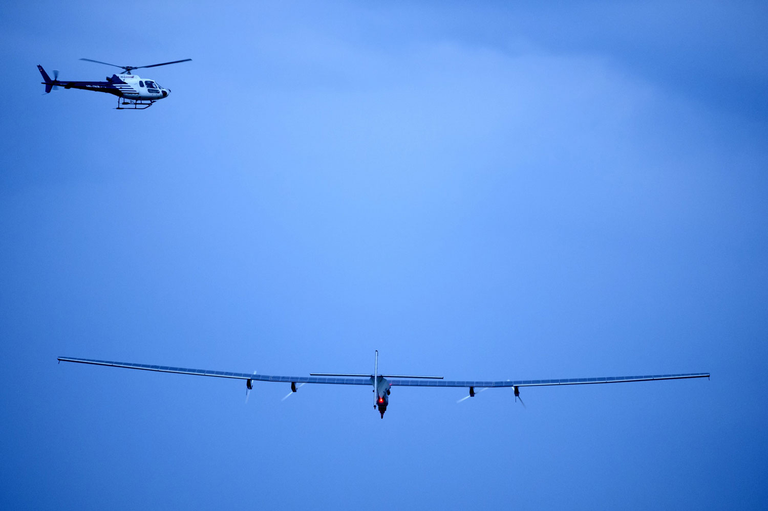 German test pilot Markus Scherdel steers Solar Impulse 2 on its maiden flight from its base in Payerne on  June 2, 2014.