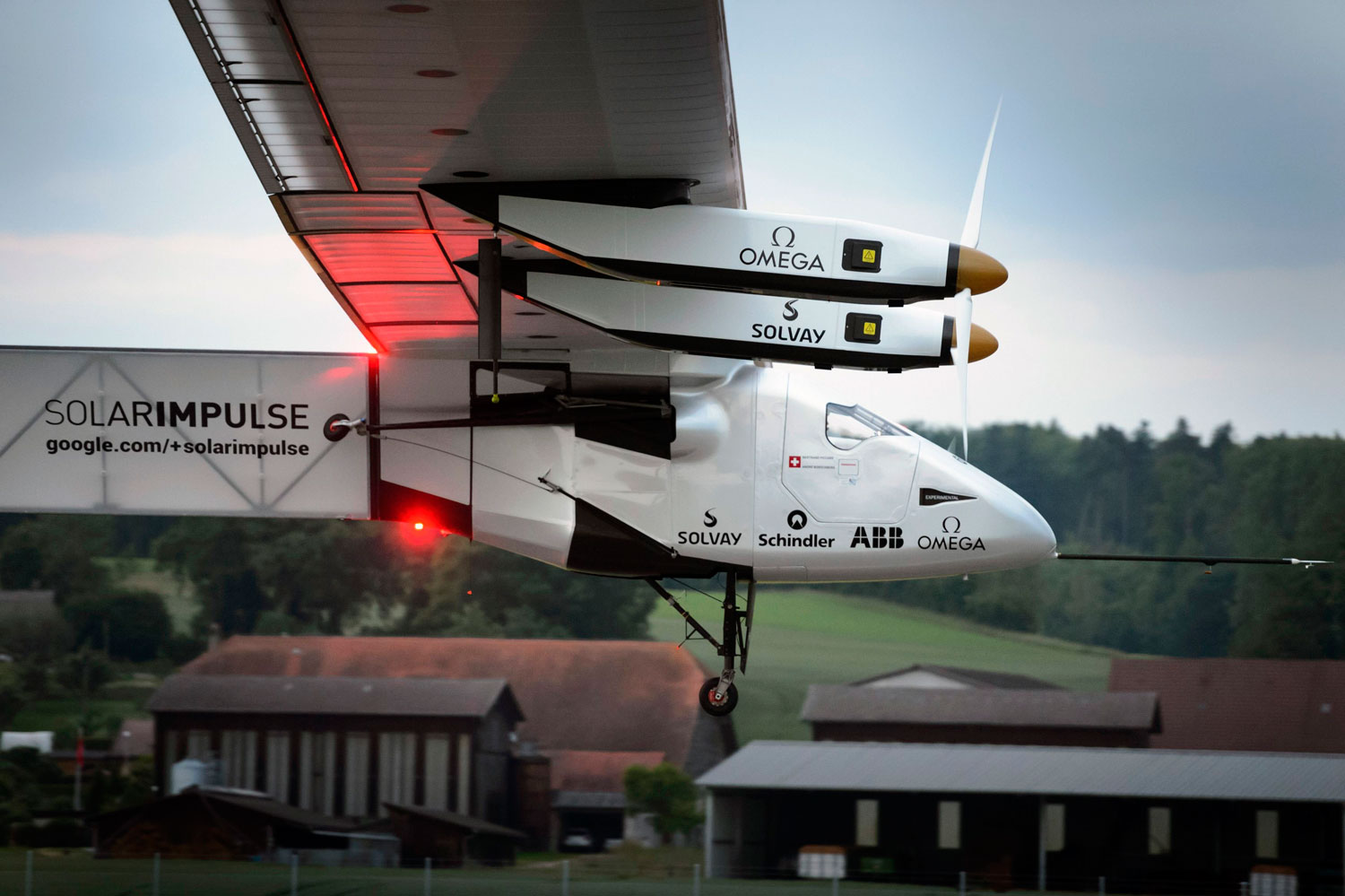 Solar Impulse 2 takes off during its maiden flight from Payerne on  June 2, 2014.