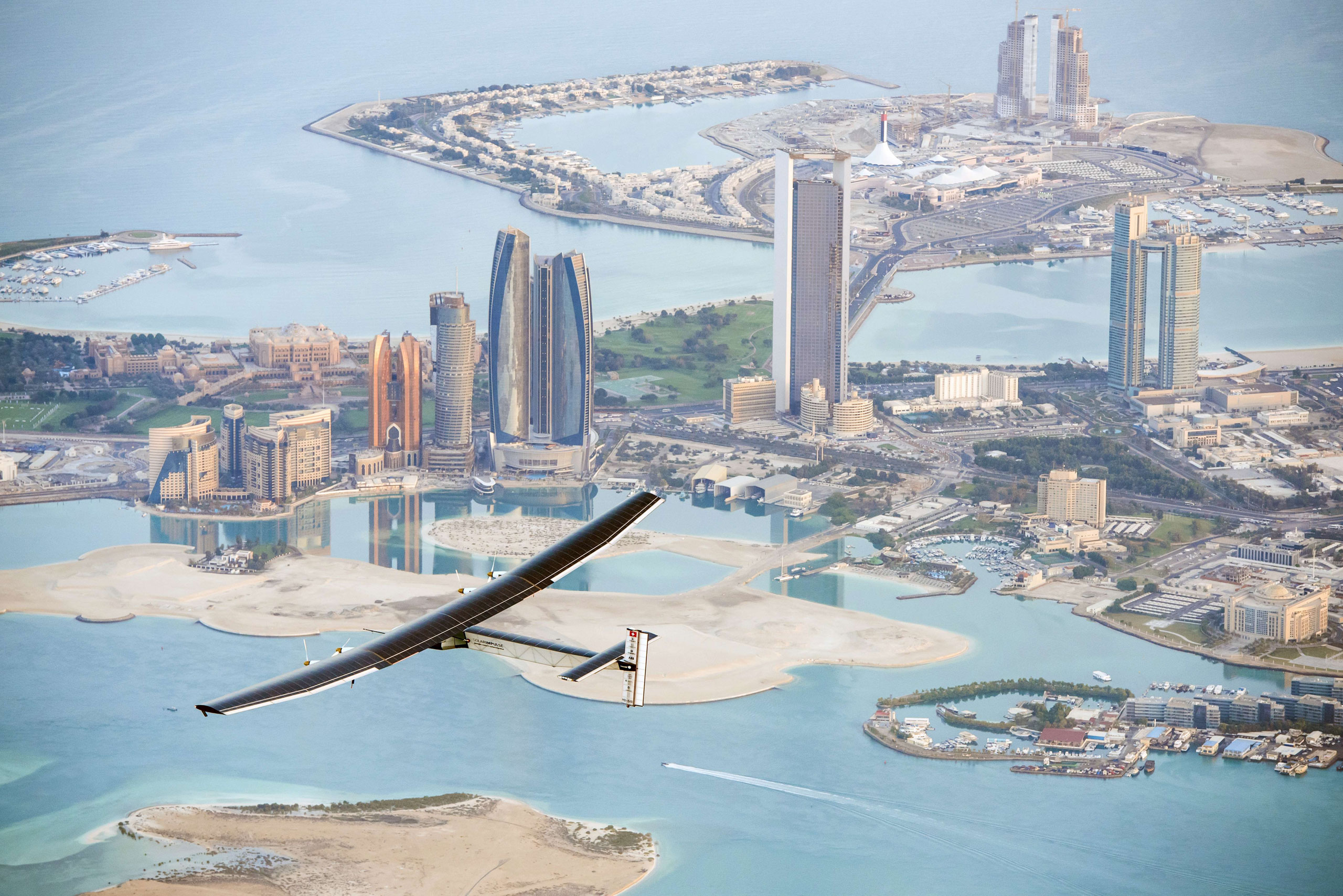 Solar Impulse 2 flies over the Emirati capital Abu Dhabi on Feb. 26, 2015 ahead of a planned round-the-world tour to promote alternative energy.