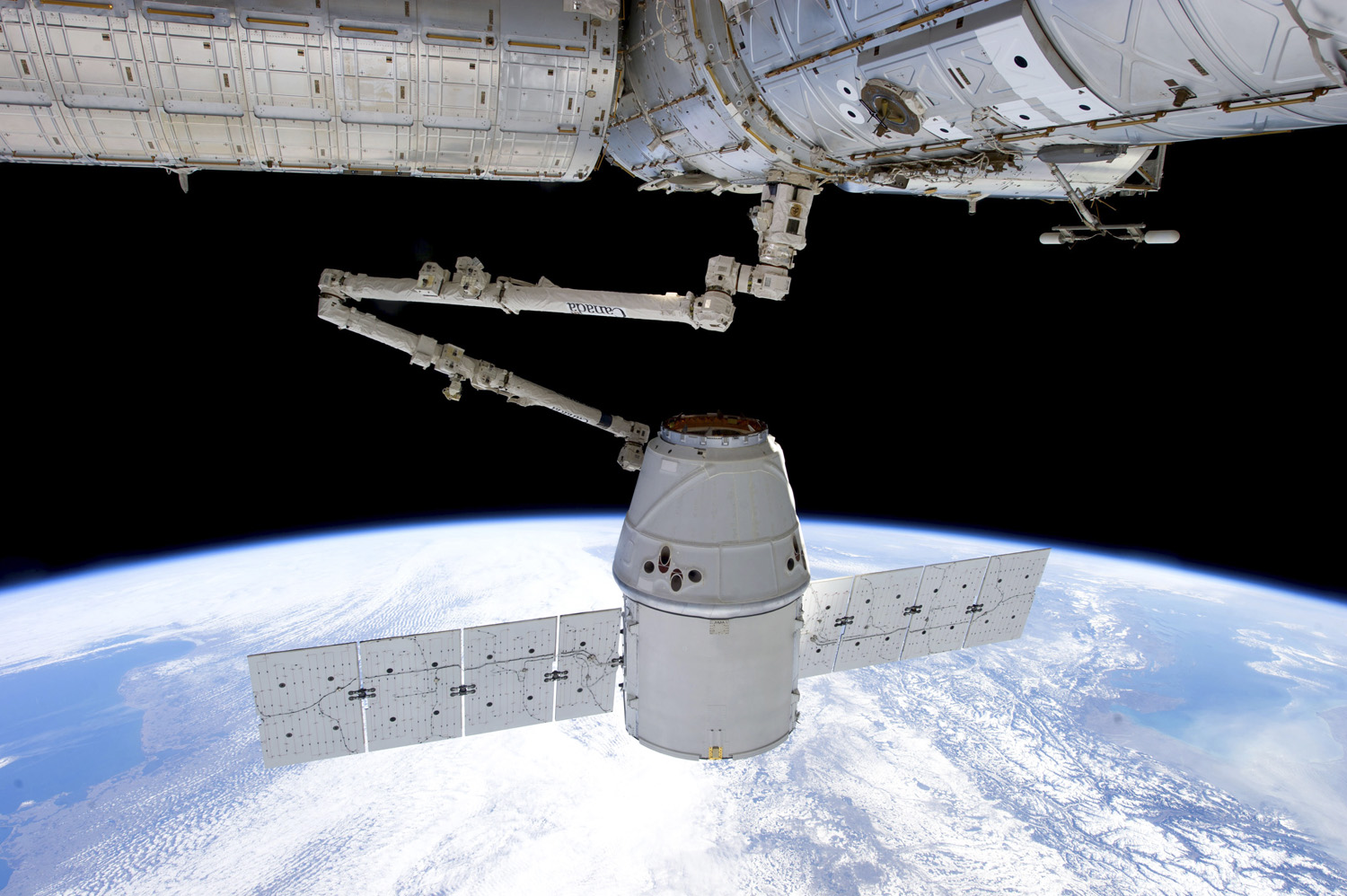 House call The SpaceX Dragon on a visit to the space station in 2013; SpaceX was the first private company to make that trip
