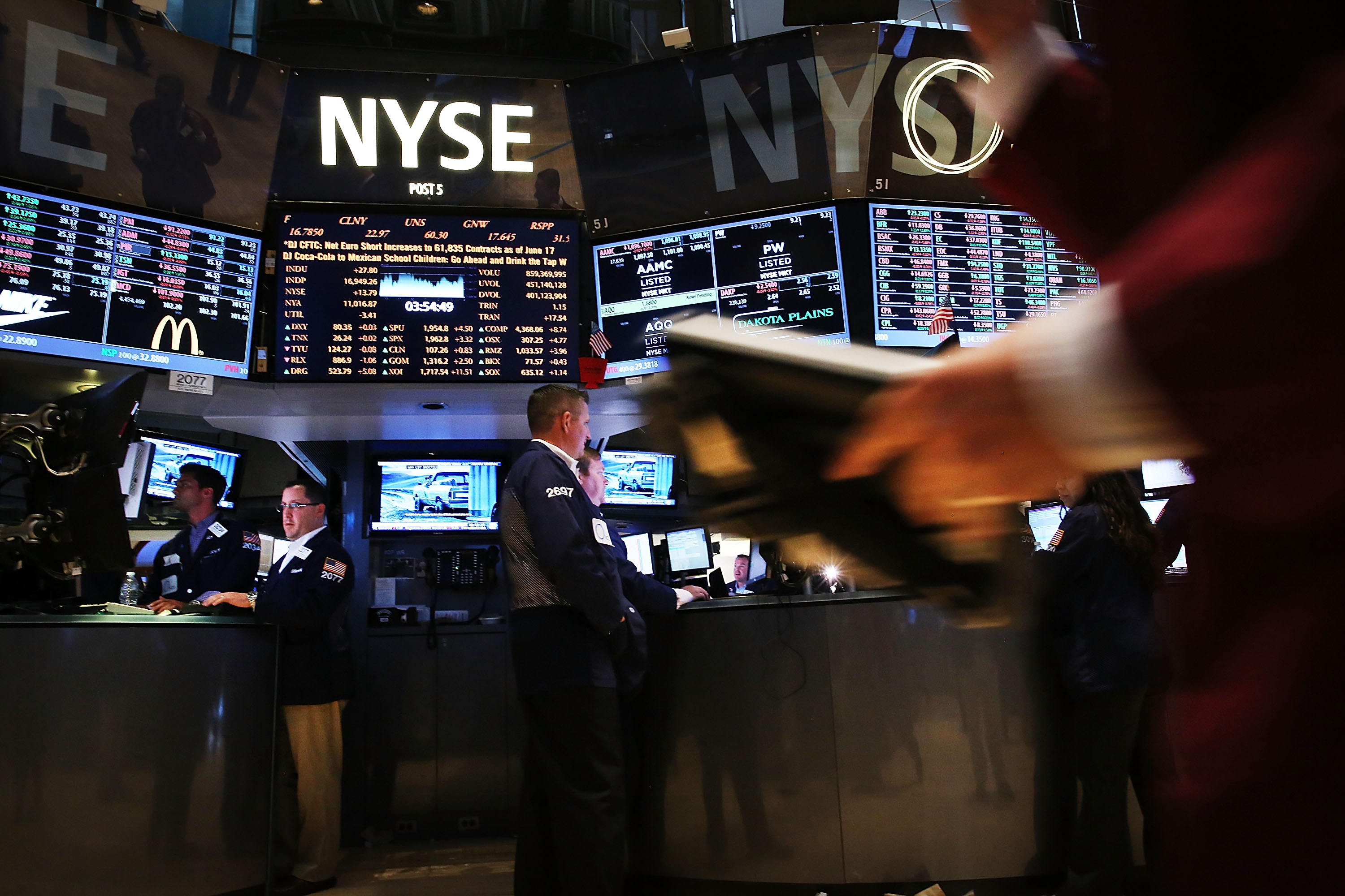Traders work on the floor of the New York Stock Exchange (NYSE) on June 20, 2014 in New York City.