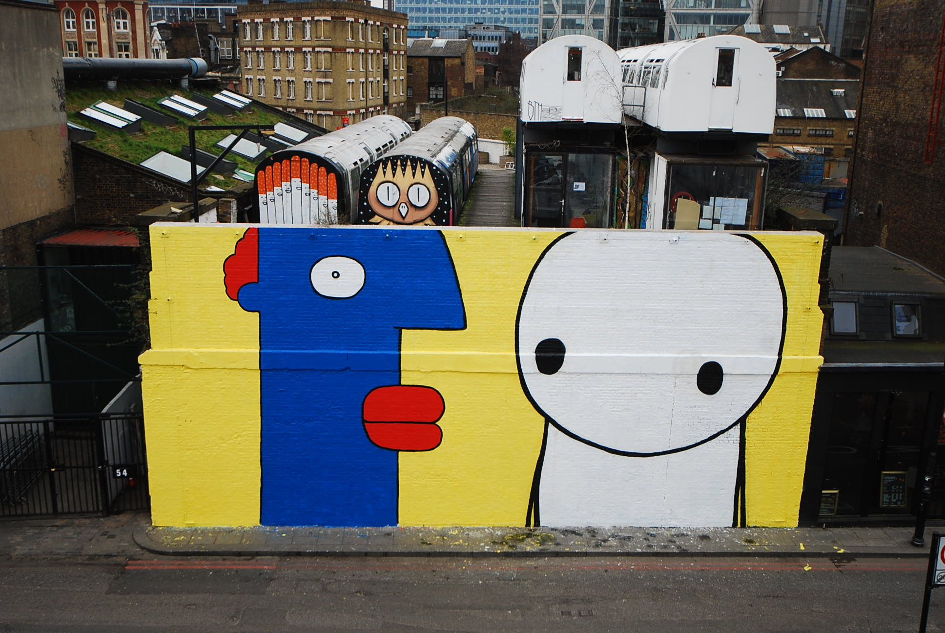 Thierry Noir and Stik's historic collaboration on The Village Underground Wall in Shoreditch, London, February 2013.