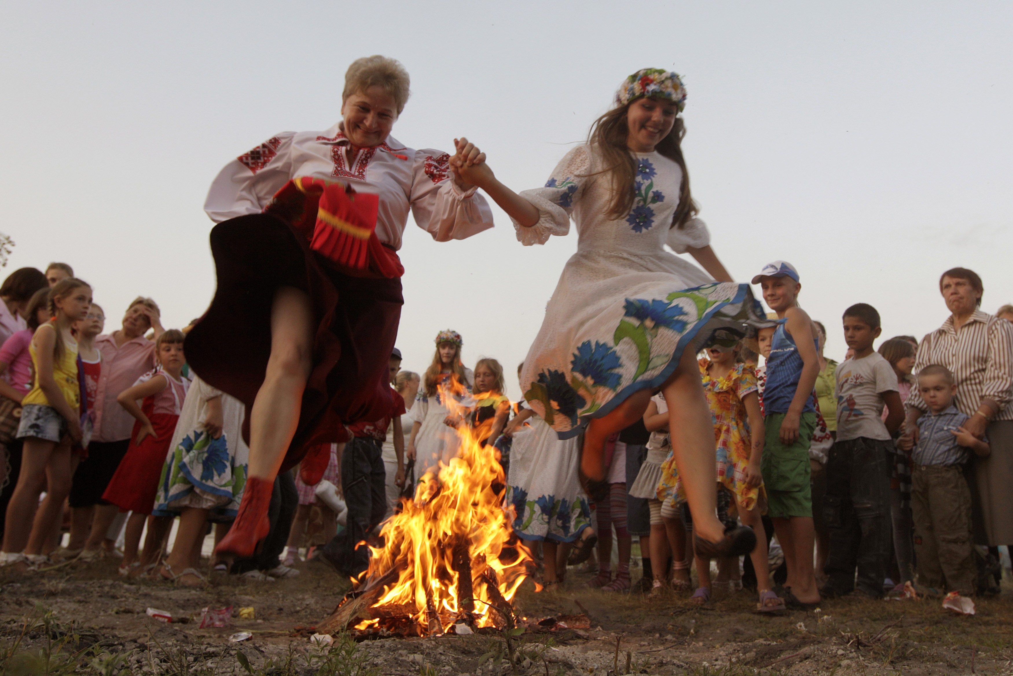 Women jump over a campfire during the Ivan Kupala festival in the town of Turov, some 167 miles south of Minsk, Russia on July 6, 2012.