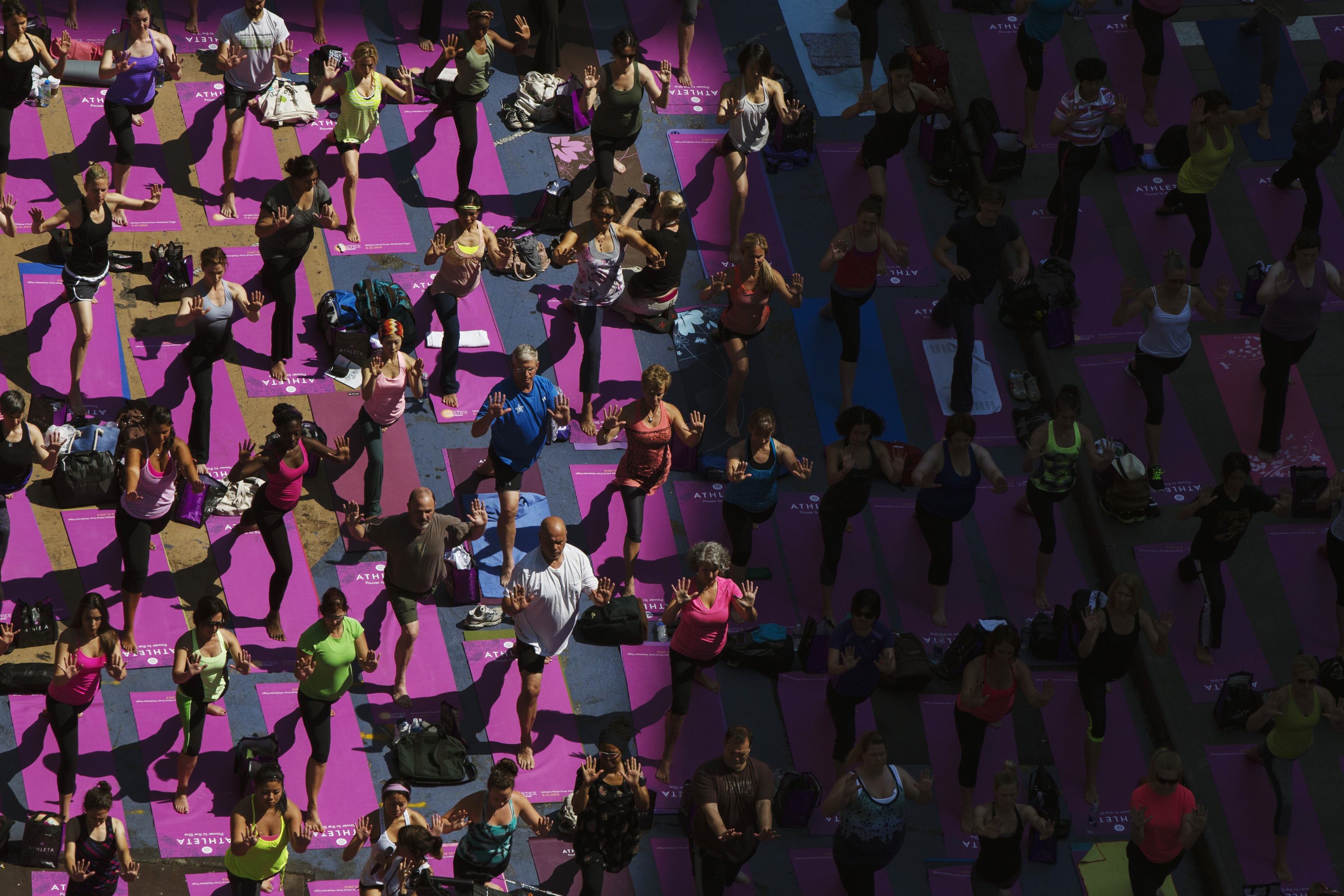 People take part in a group yoga practice on the morning of the summer solstice in New York's Times Square on June 21, 2013. The  Solstice in Times Square  event on Friday brought out thousands of participants to celebrate the year's longest day in New York.