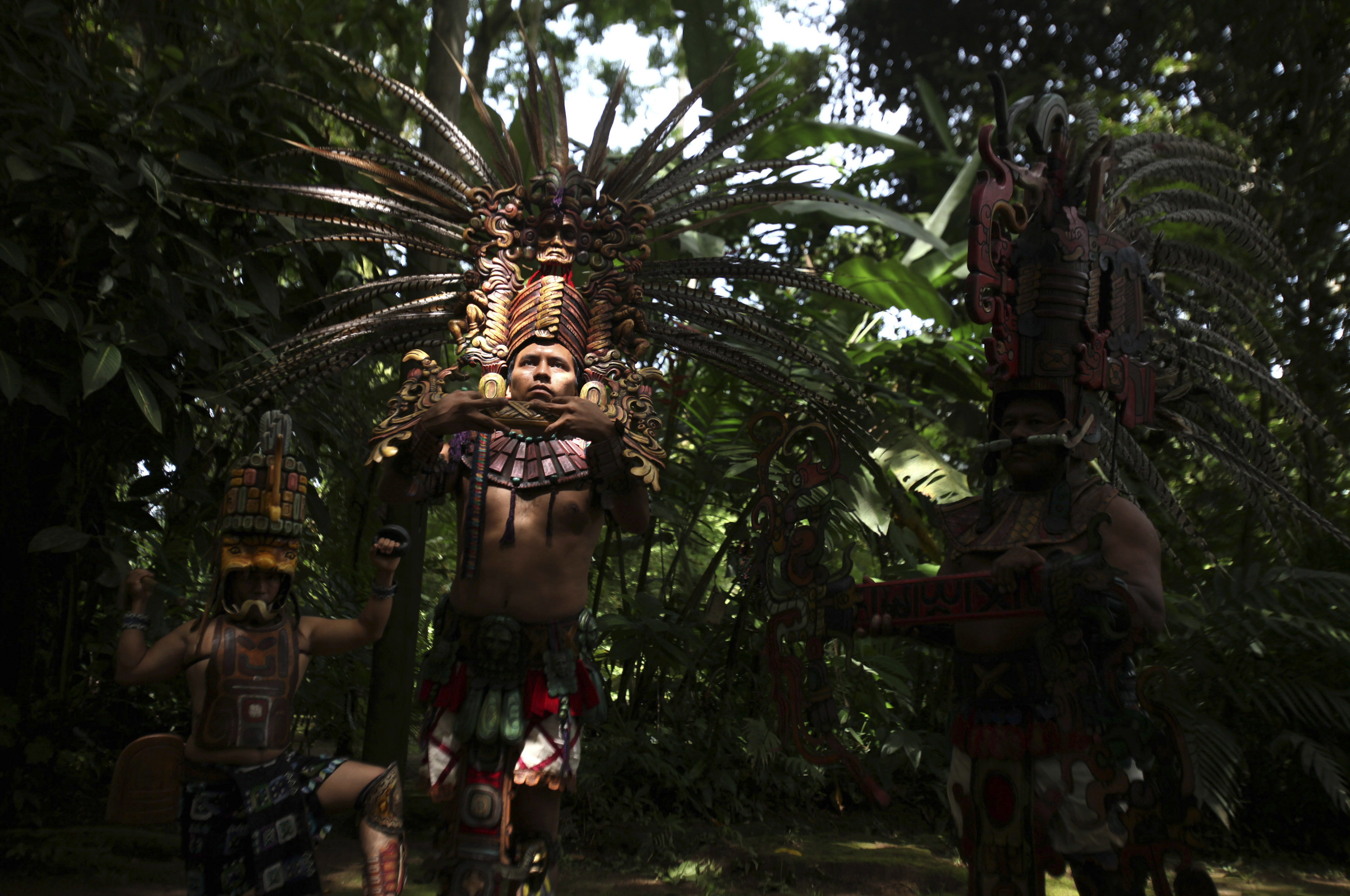 Performers participate in a pre-hispanic dance to celebrate the beginning of the Summer Solstice during the inauguration of a museum at the archaeological site of Tak'Alik A'Baj in Retalhuleu, some 124 miles from Guatemala City on June 21, 2012.