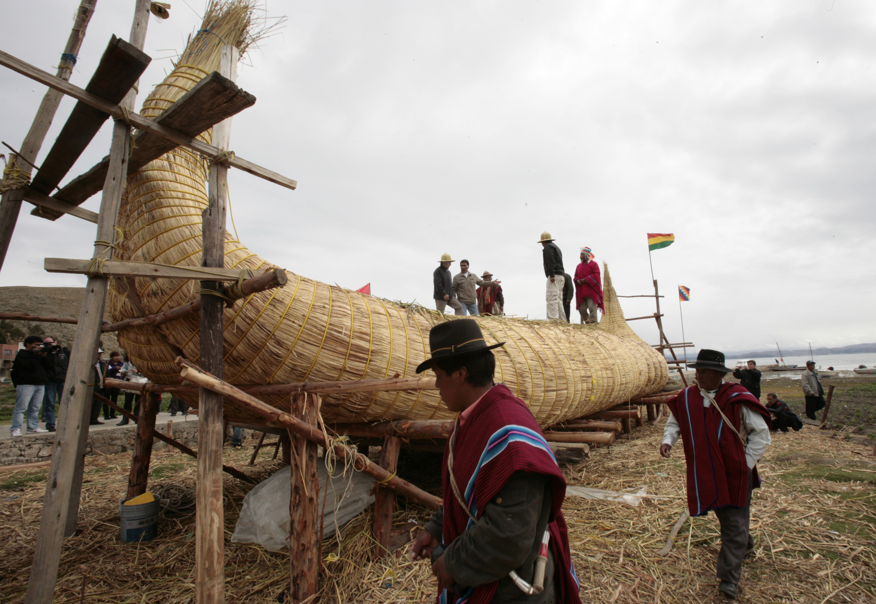 Members of the Limachi family, and others from the community living along the shores of Lake Titacaca, inspect a reed boat in Suriqui island on Lake Titicaca, some 50 miles northwest of La Paz, Mexico on December 2, 2012. The boat, sponsored by Bolivia's government, was built for the summer solstice.