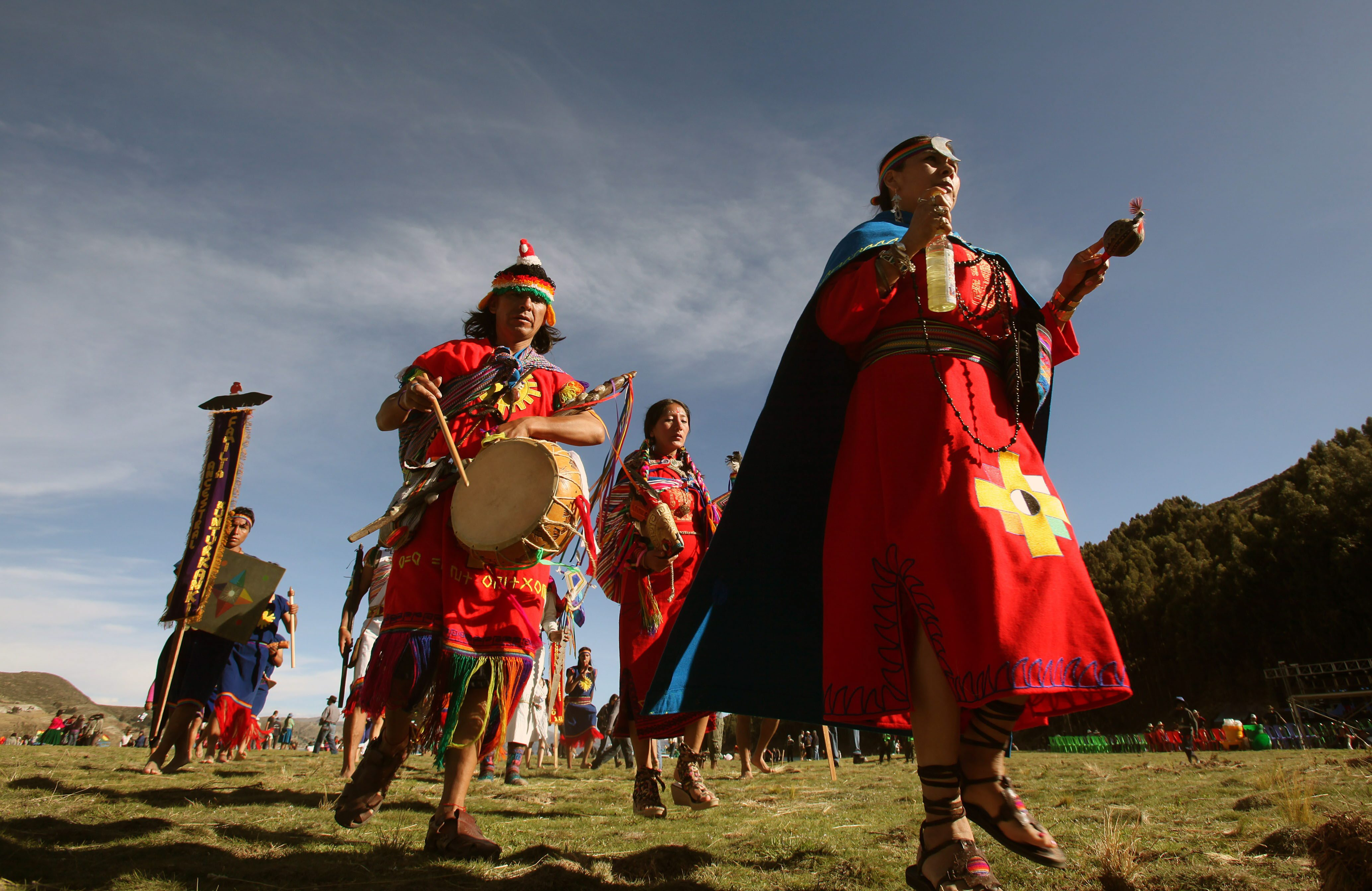 Members of Peruvian ancestral Kunturkanki indigenous community participate in a traditional marriage at the Isla del Sol (Island of the Sun) in the Titicaca Lake in Bolivia on December 20, 2012.
