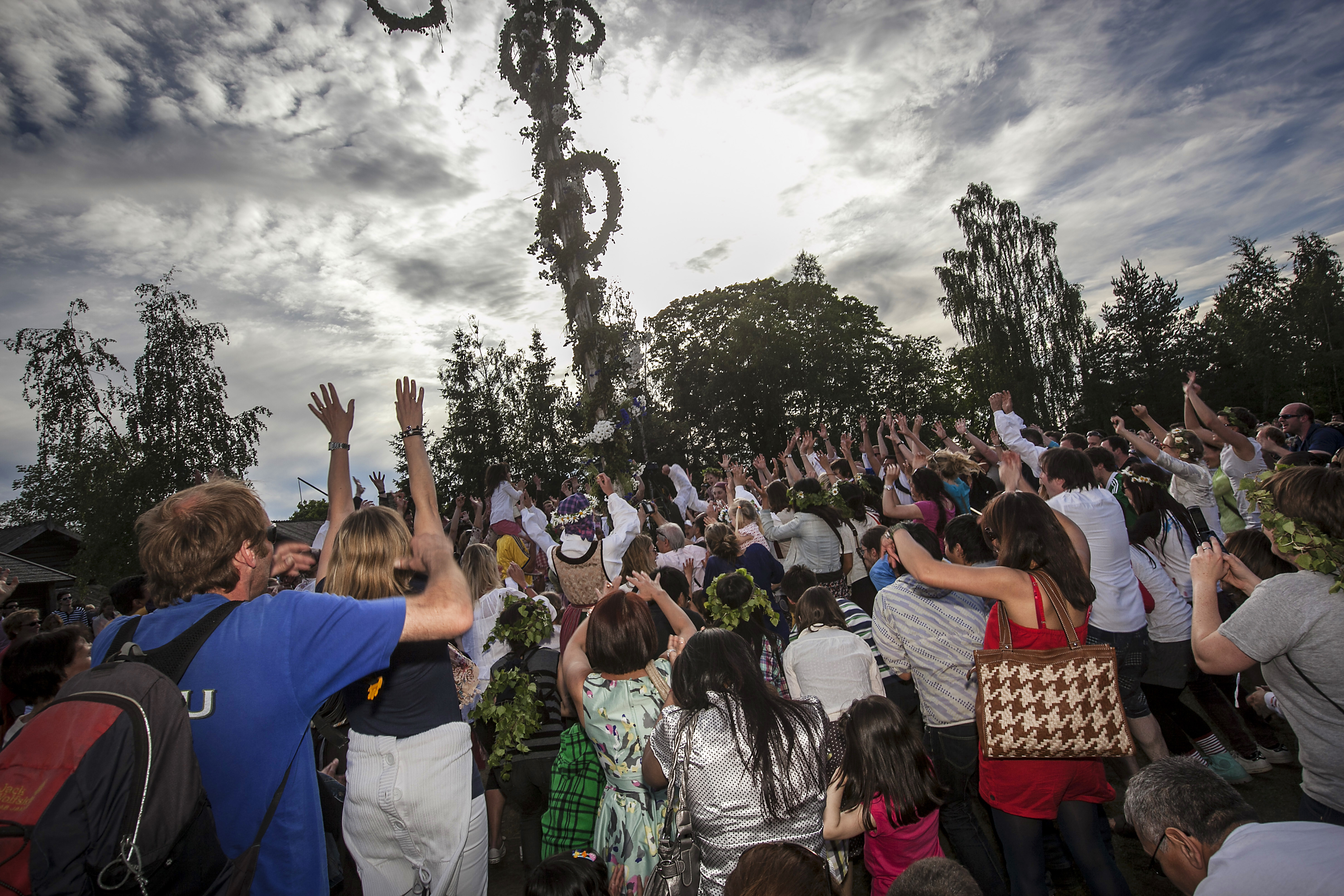 Swedes perform a popular dance around the  ''maypole'' during the celebrations held in Stockholm, Sweeden to commemorate the Midsummer's Eve on June 22, 2012.