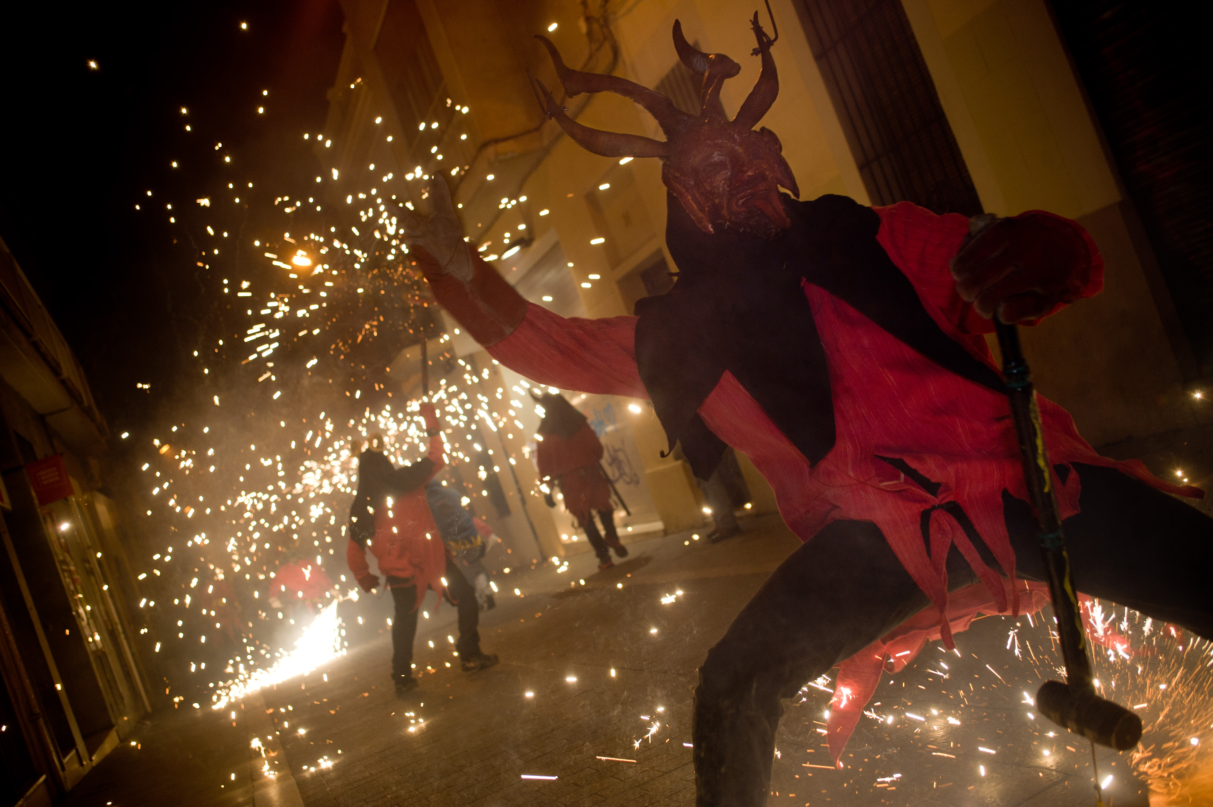 Devils dance amidst pyrotechnics at The Festival of Els Foguerons de sa Pobla, a Mallorcan celebration held in the Grcia district of Barcelona.