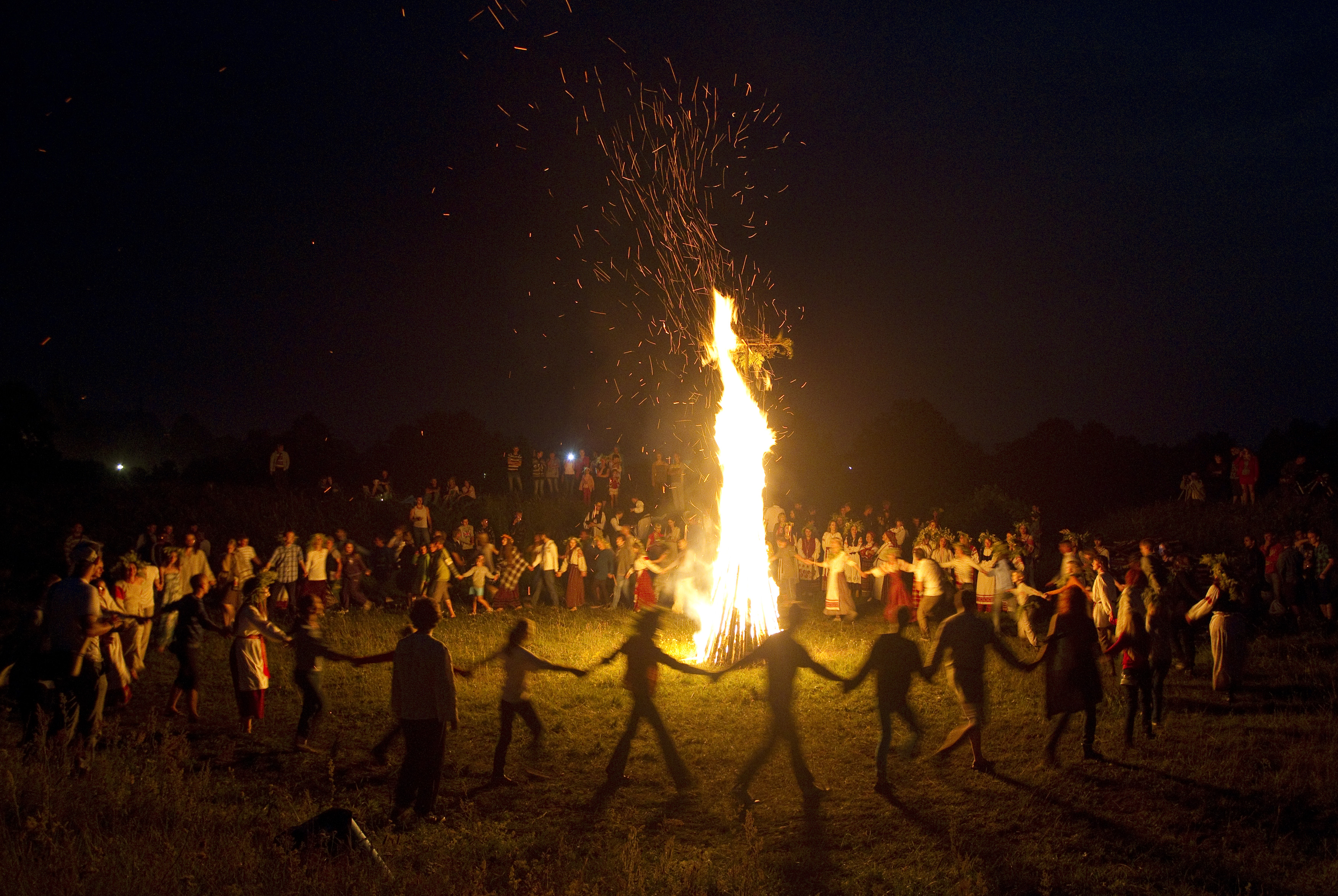 People take part in the Ivan Kupala festival near the town of Rakov, some 28 miles west of Minsk, Belarus on June 22, 2013. The traditional festival celebrates the summer solstice with overnight festivities as they believe it will purge them of their sins and make them healthier.