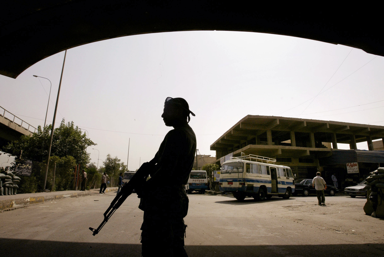A member of the U.S.-backed Neighborhood Patrol Awakening Council stands guard in the Sunni Adhamiya district north of Baghdad in 2008.