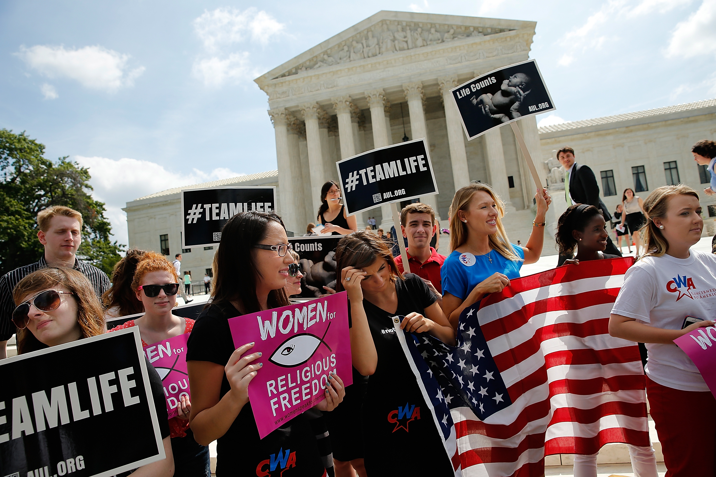 Pro-life activists gather outside the U.S. Supreme Court June 26, 2014 in Washington, DC.