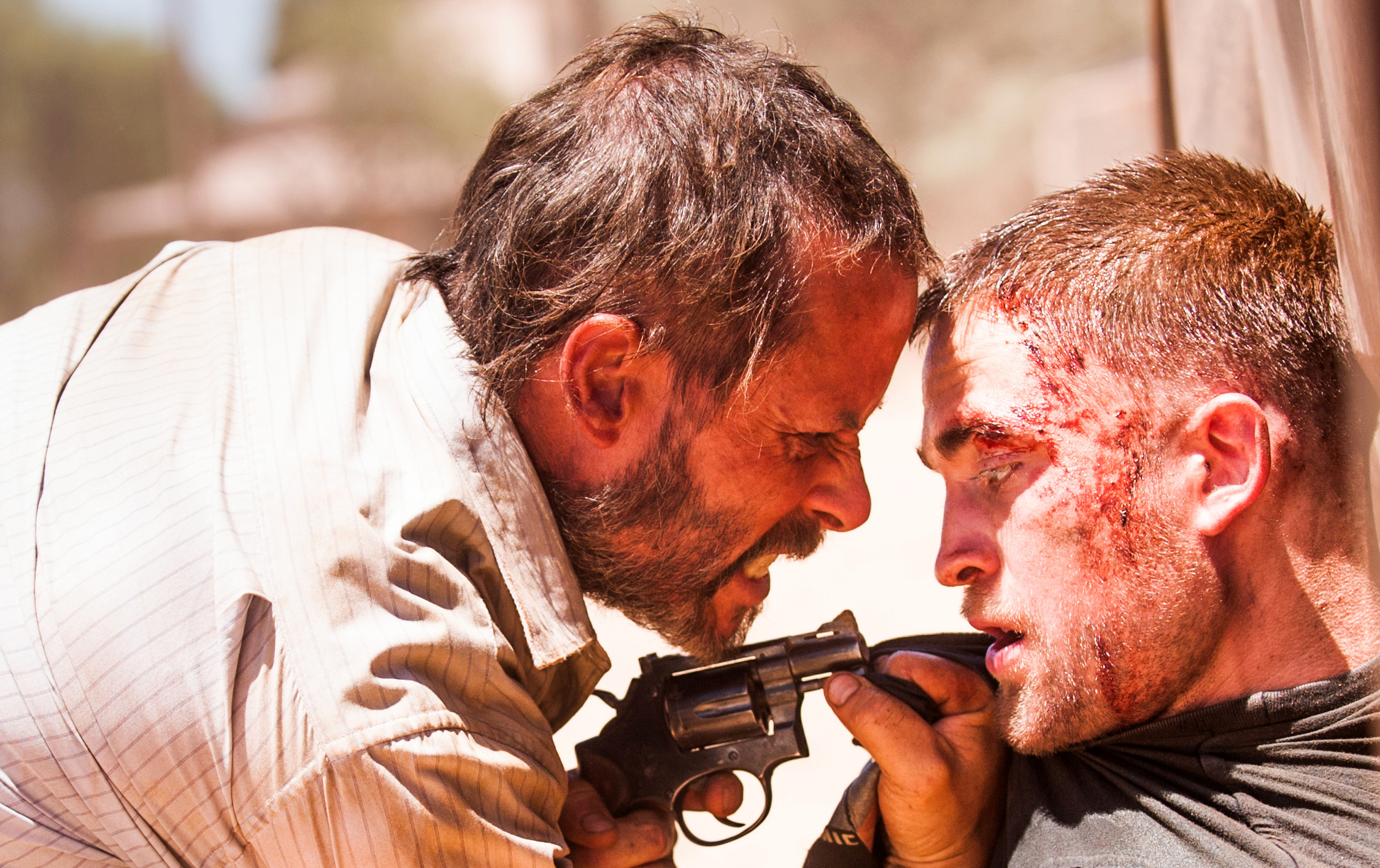 Guy Pearce, left, and Robert Pattinson in a scene from  The Rover.