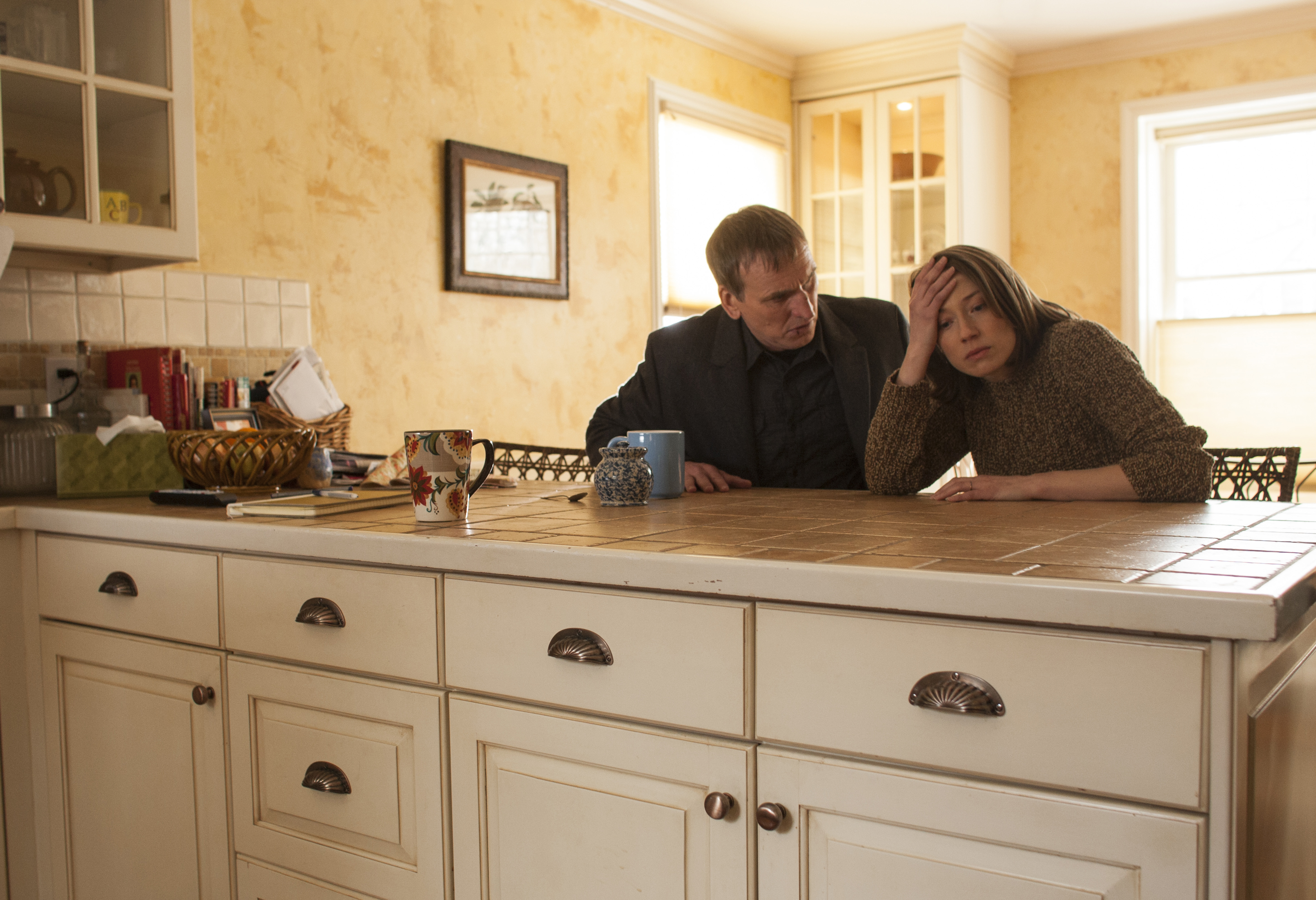 Christopher Eccleston as Reverend Matt Jamison and Carrie Coon as Nora Durst in the episode  Two Boats and a Helicopter  in the HBO show The Leftovers.