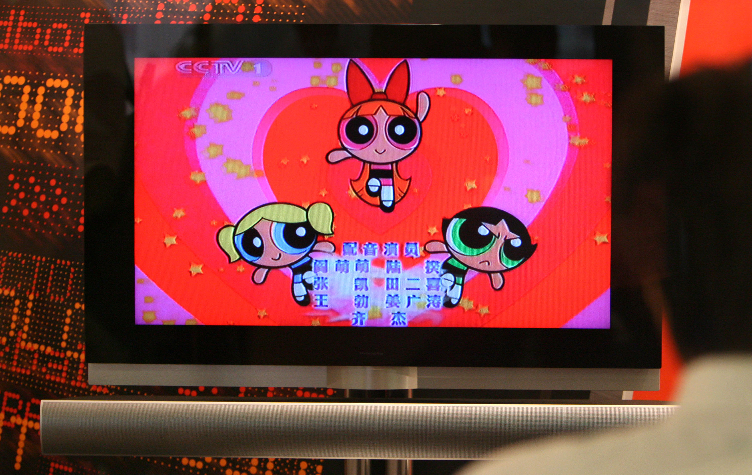 A vendor looks at Cartoon Network's Powerpuff Girls American cartoon.