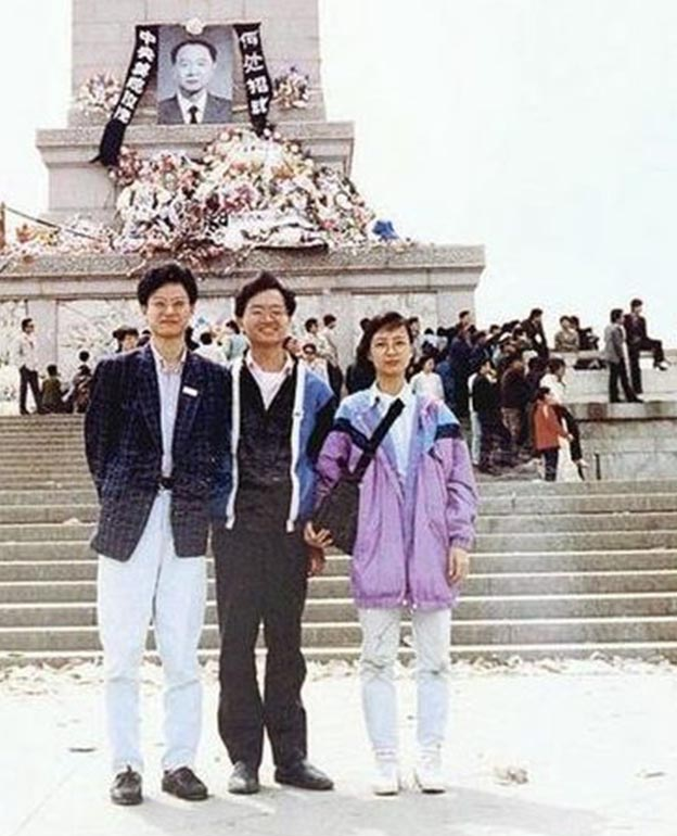 Kenneth Lam (left), Liane Lee (right) and another activist (name unknown) pose in front of the Monument to the People's Heroes, in Tiananmen Square, Beijing, in April 1989.