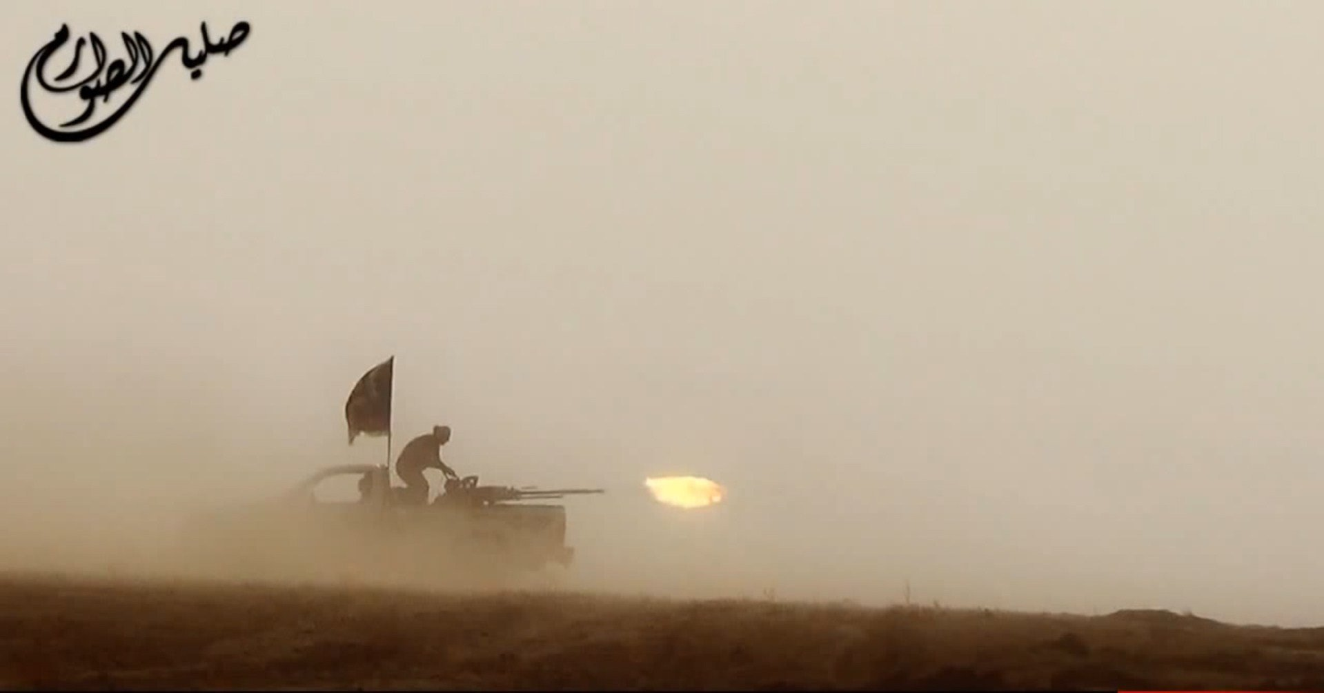 An image grab taken from a propaganda video uploaded on June 8, 2014, by the jihadist group the Islamic State of Iraq and the Levant (ISIL) allegedly shows ISIL militants firing from the back of a vehicle near the central Iraqi city of Tikrit.