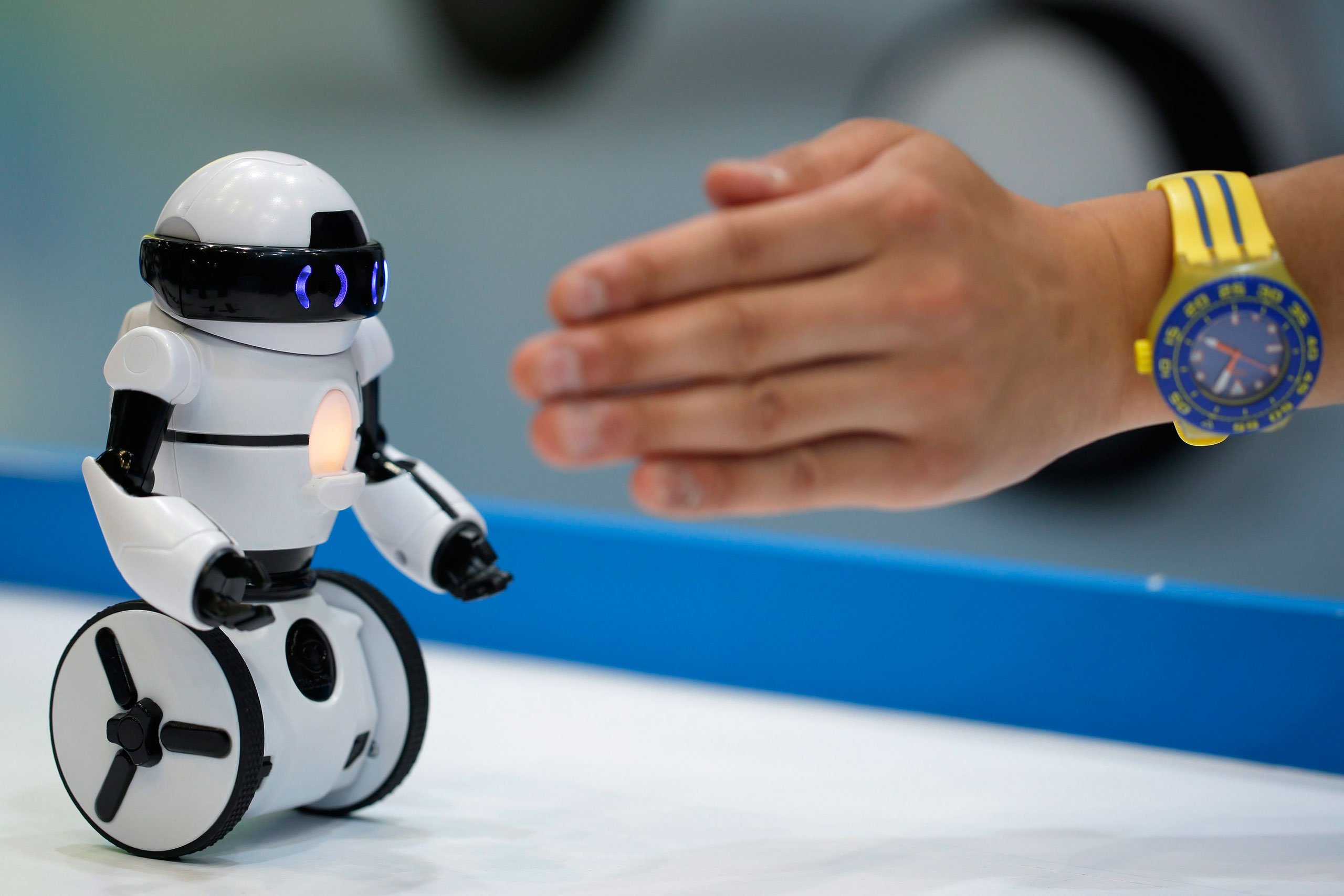 The 'Hello! MiP' entertainment robot responds to hand gestures during a demonstration at the International Tokyo Toy Show 2014 in Tokyo, Japan, 12 June 2014.