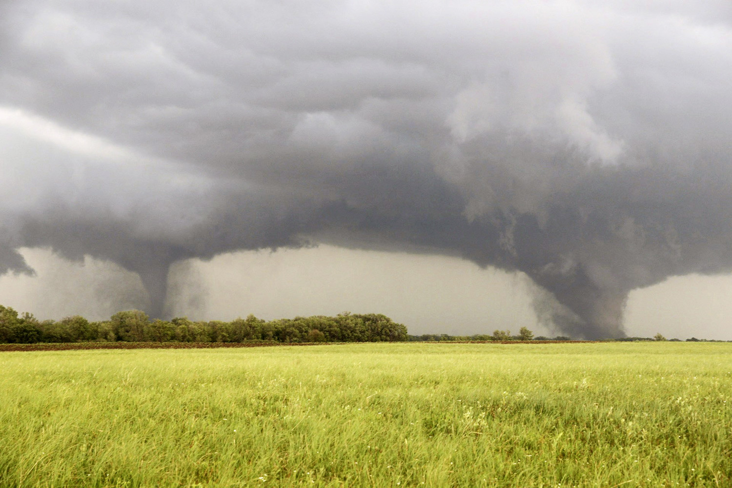 A pair of tornadoes barrel toward Pilger, Neb., on June 16. The twisters uprooted trees and flattened houses across the tiny village (pop. 352). Two residents, including a 5-year-old girl, died as a result of the storm.