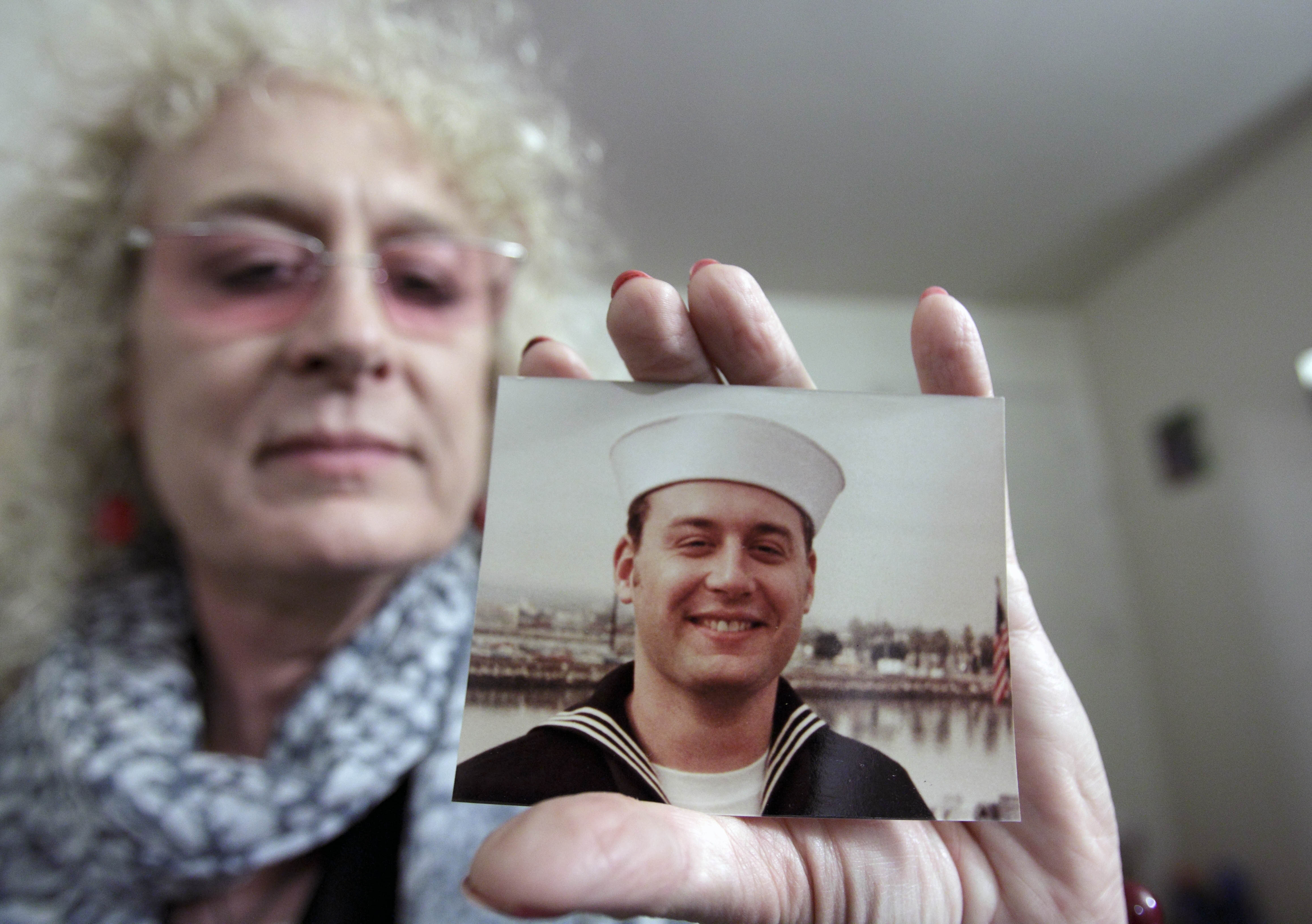 Autumn Sandeen holds a November, 1980 picture of herself as a man and navy seaman recruit on Nov. 23, 2010 in San Diego.