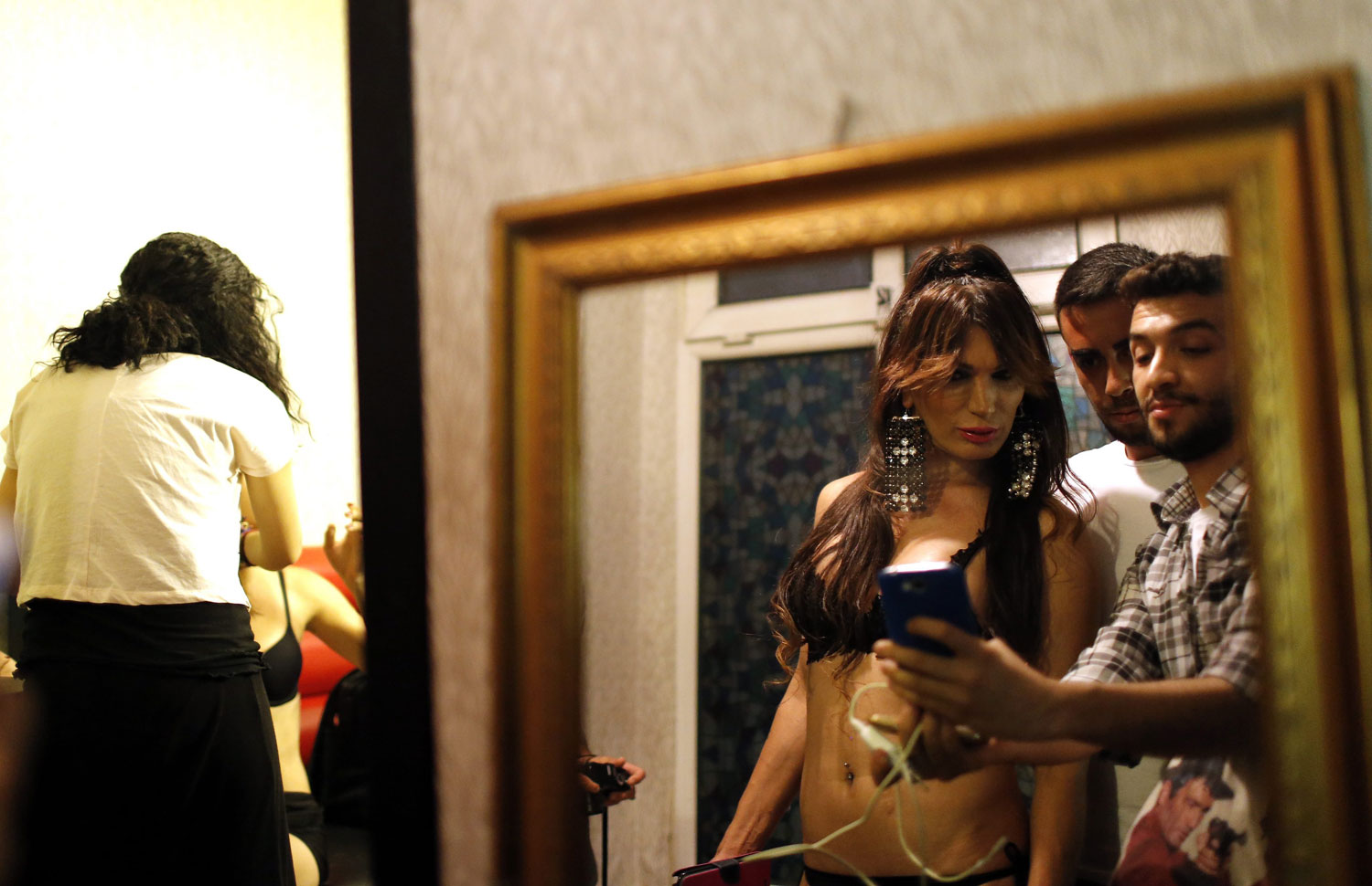 Contestants prepare backstage in Istanbul on June 21, 2014. The contest provided a moment of relief at a time when Turkey's LGBT community faces continual violence, as well as legal and social discrimination.