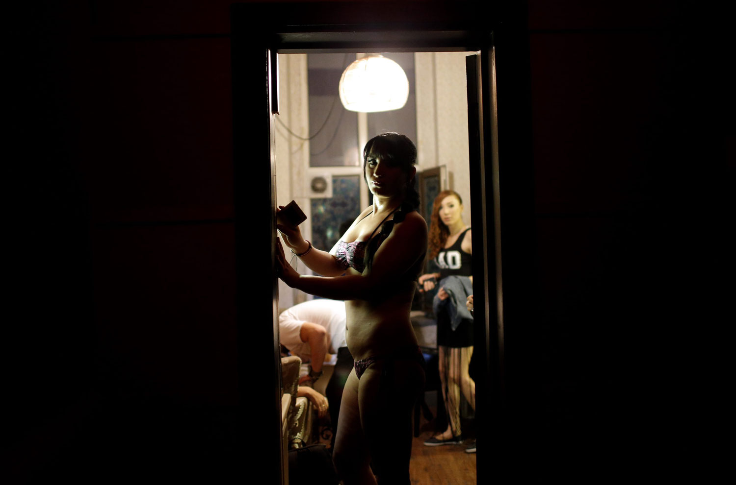 A contestant waits backstage in Istanbul on June 21, 2014. Many Turkish transsexuals are forced into becoming sex workers once their sexuality is exposed to their communities.