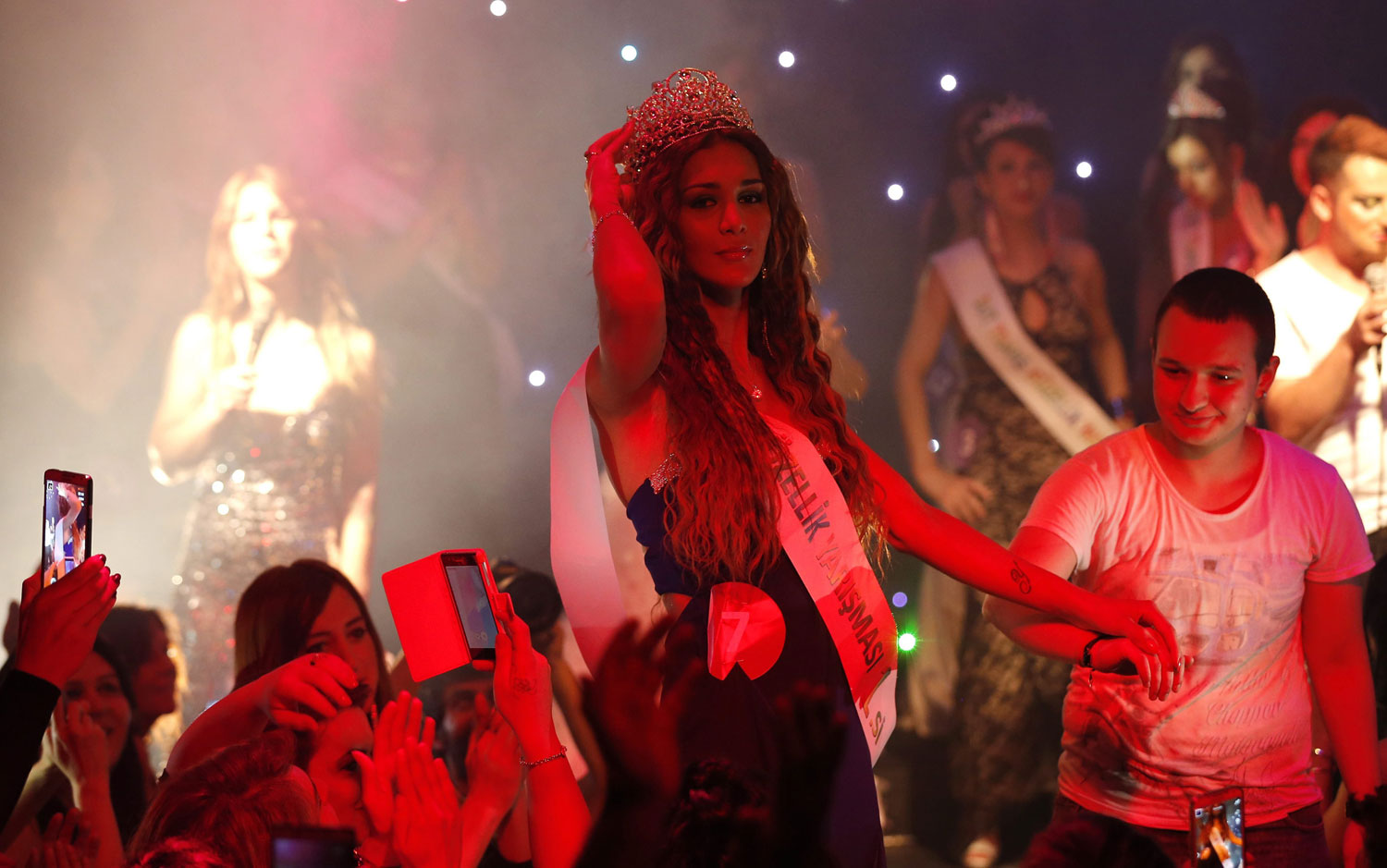 Yanki Bayramoglu poses for pictures after winning the contest in Istanbul on June 21, 2014. According to Amnesty International, transsexuals in Turkey constantly face hate crimes, harassment, and honor killings which are generally overlooked - or perpetrated - by police and government officials.
