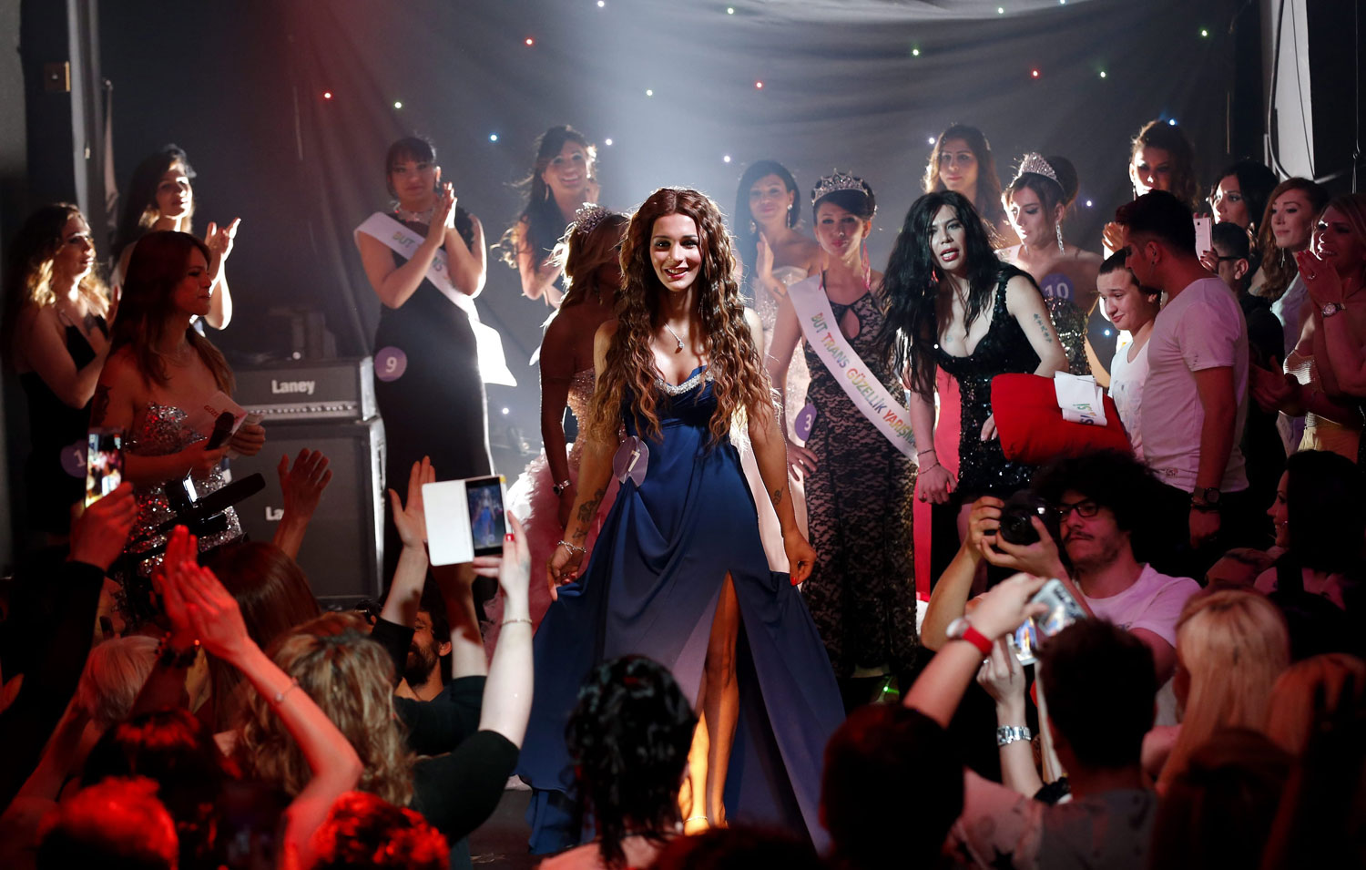 Yanki Bayramoglu takes center stage after winning the pageant in Istanbul on June 21, 2014. Turkey's LGBT community continues to expand and make strides both in the social and political arenas.