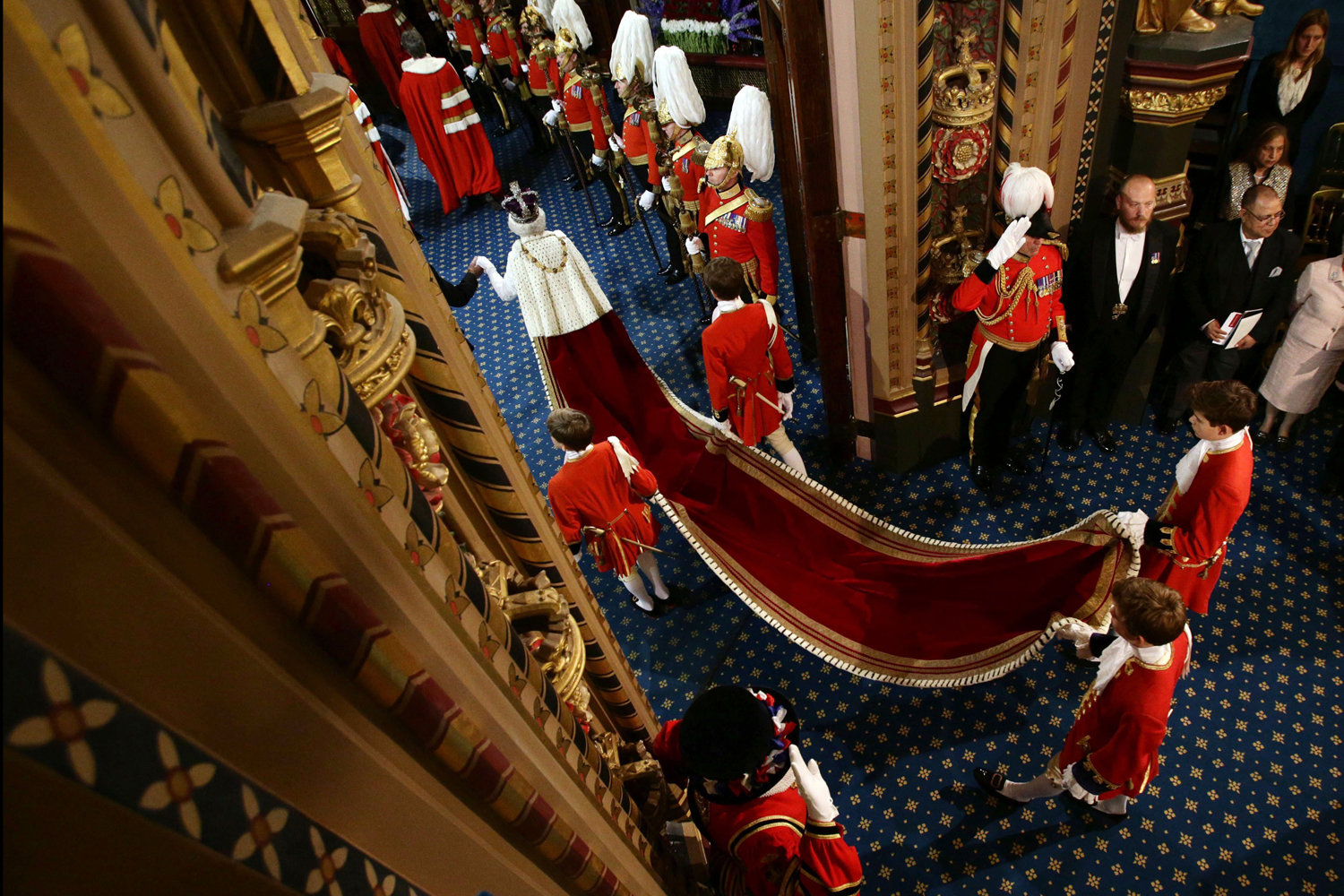 June 4, 2014.  Britain's Queen Elizabeth II and Prince Philip, Duke of Edinburgh proceed through the Royal Gallery during the State Opening of Parliament in the House of Lords at the Palace of Westminster in London.