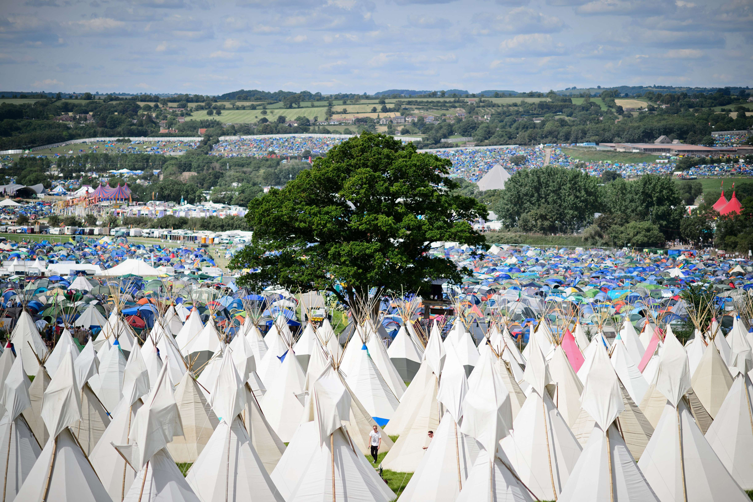 Jun. 25, 2014. Finishing touches are made to the tipis as the gates open at the Glastonbury Festival of Music and Performing Arts in Somerset, southwest England.