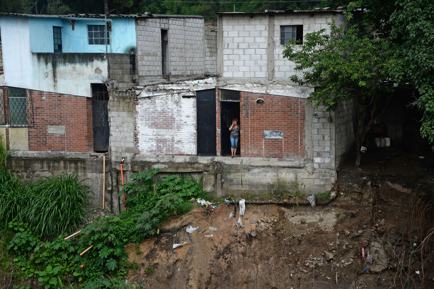 June 3, 2014. View of the homes at risk after part of one collapsed due to heavy rains in Villa Hermosa, San Miguel Petapa municipality, 20 km south og Guatemala City.