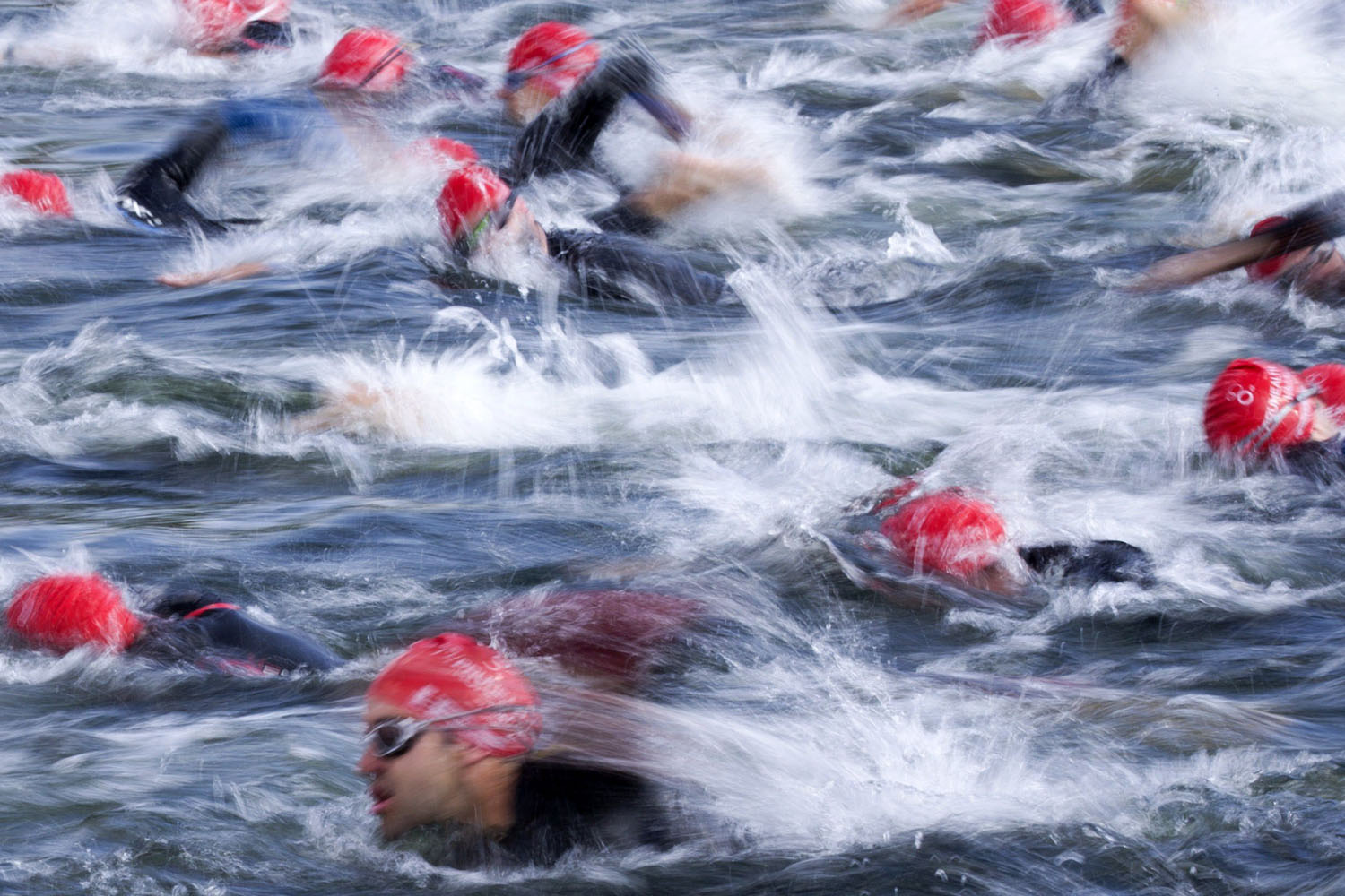 June 1, 2014. Competitors in the open race over the Olympic distance in the World Triathlon London, the fourth event in the 2014 ITU World Triathlon Series, swim through the Serpentine in Hyde Park, London.