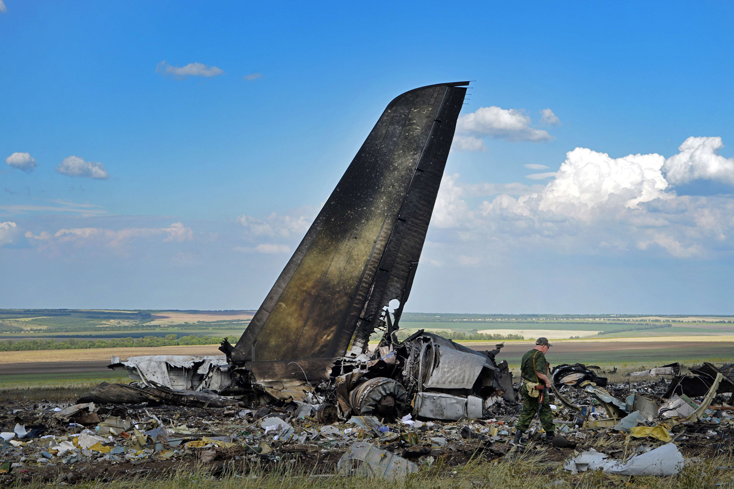 Jun. 14, 2014.Pro-Russian militants look through the debris of an IL-76 Ukrainian military transporter which was taken down by pro-Russian rebels early on June 14, on the outskirts of Lugansk.