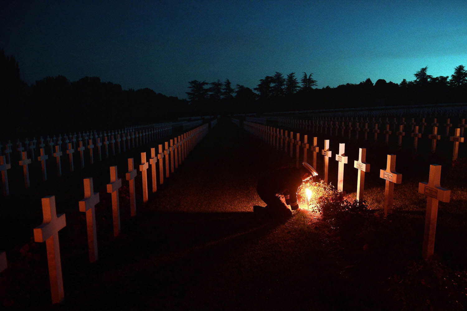 Jun. 22, 2014. Torchlights are placed next to soldiers' tombs at the Douaumont's boneyard, eastern France, during the annual event known as The Four Days of Verdun, a night parade of veterans, as they commemorate the Verdun battle 98th anniversary.
