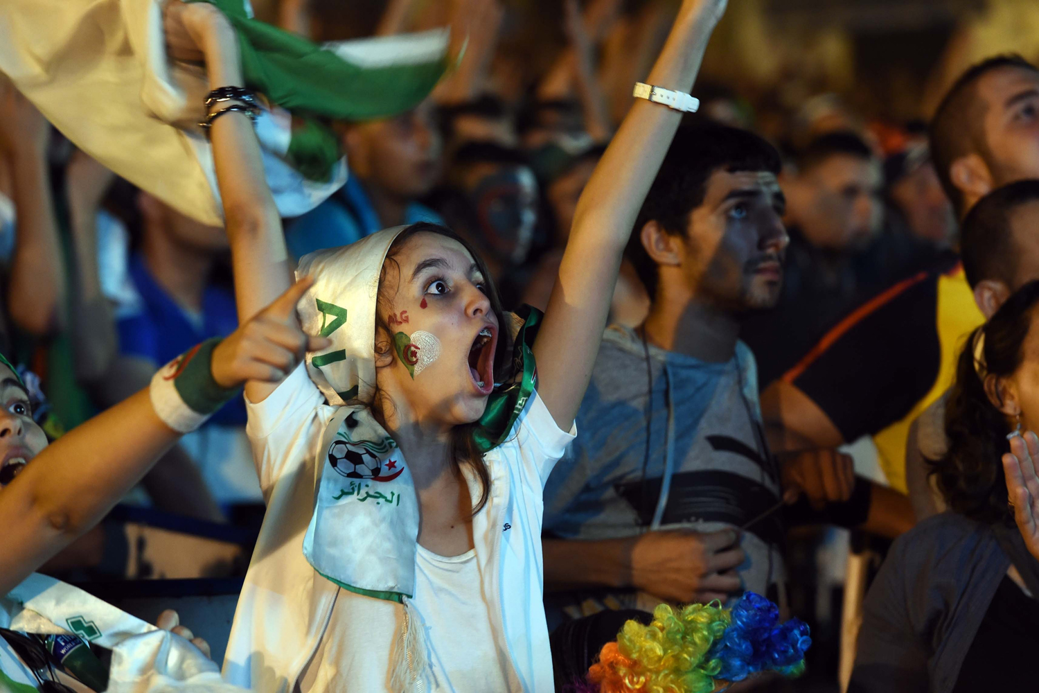 Jun. 26, 2014. Algerian fans celebrate in Algiers on after Algeria eliminated Russia with a 1-1 draw in a FIFA 2014 World Cup Group H match.